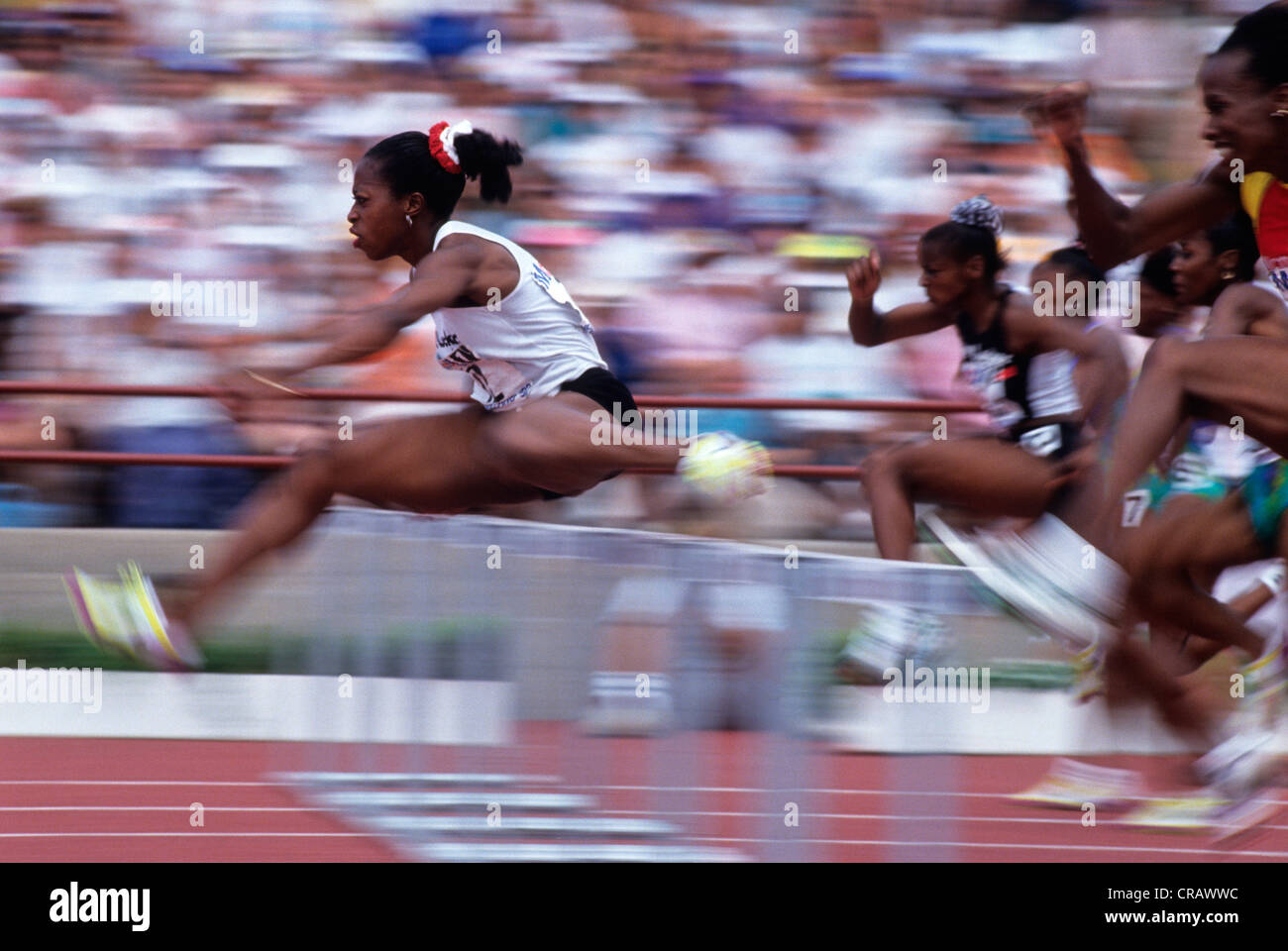 Gail Devers competing in the 100 meter hurdles at the 1992 US Olympic Track and Field Trials. - Stock Image
