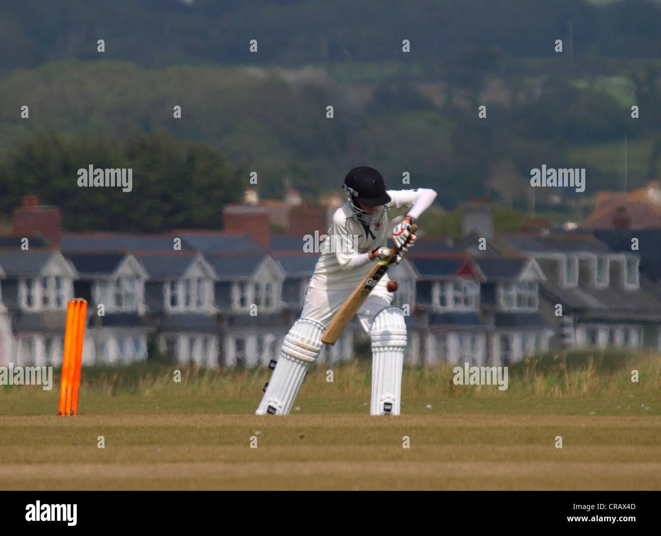 Junior batsman playing a defensive shot, Bude, Cornwall, UK - Stock Image
