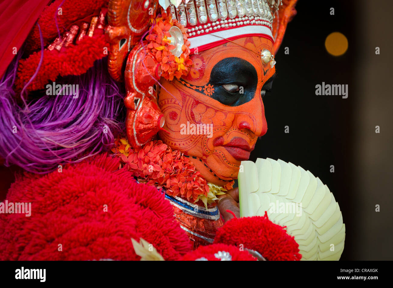 Performer wearing colourful make-up, Theyyam ceremony, near Kasargod, Kerala, Southern India, India, Asia - Stock Image