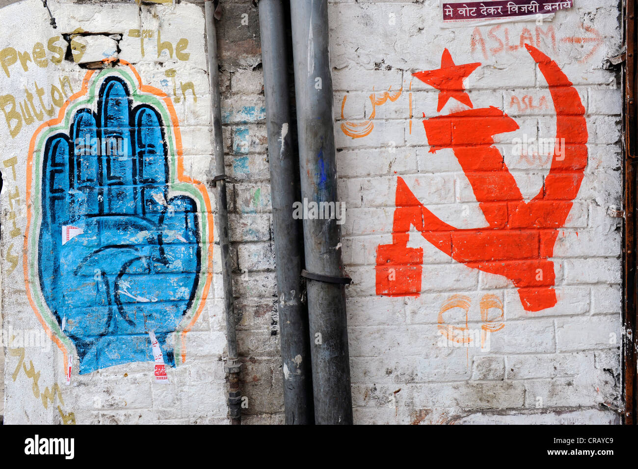 Symbols Of The Indian Congress Party And The Communist Party Painted