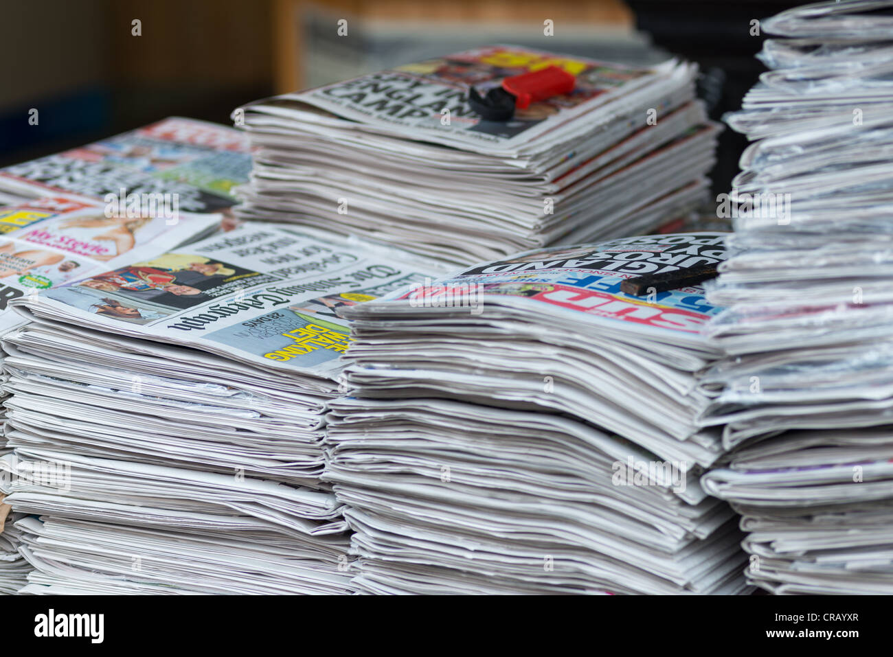 British newspapers on sales at stall in London, England. - Stock Image