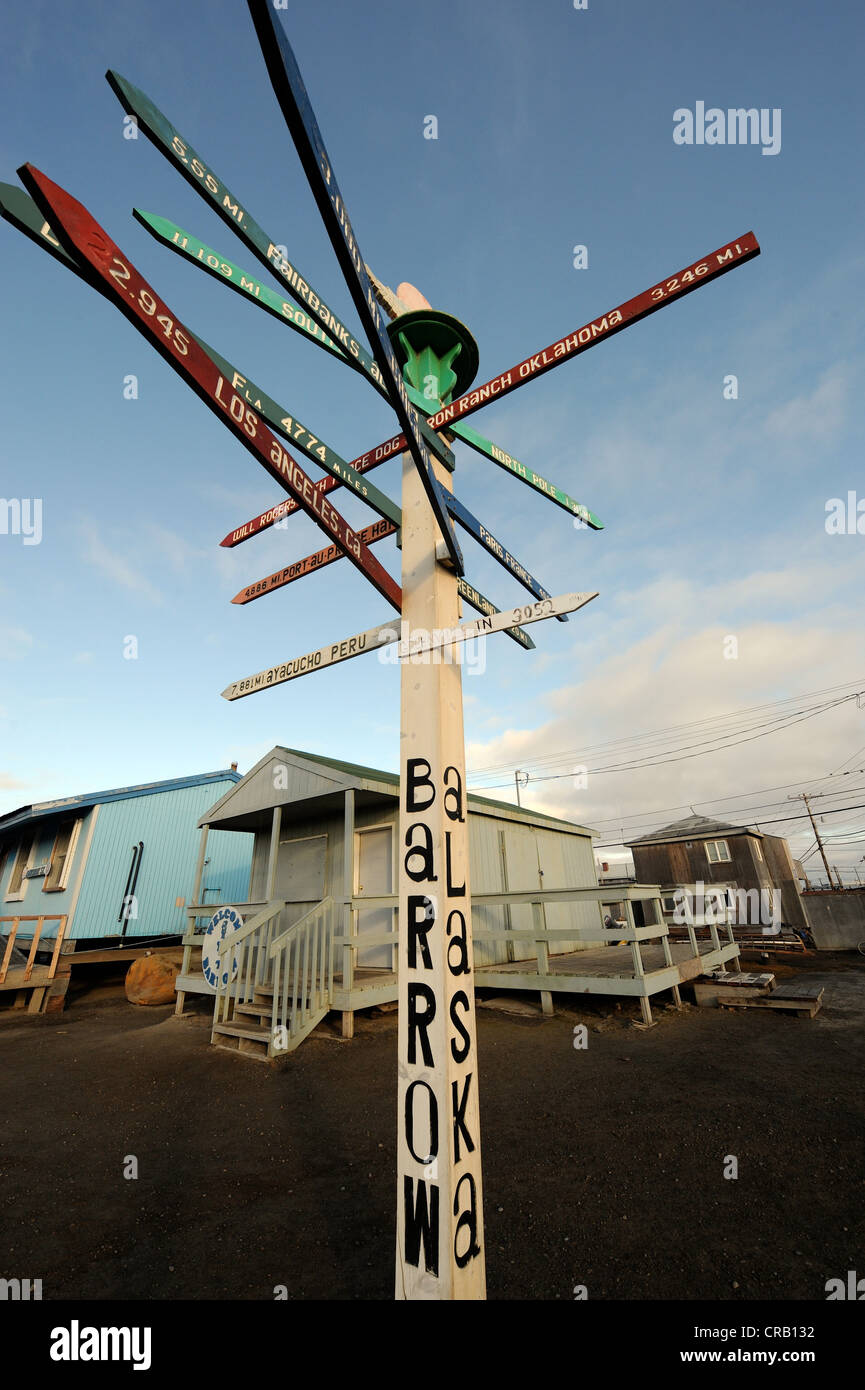 Signpost with distances to cities and other landmarks, Barrow, Alaska, the northernmost city in the US - Stock Image