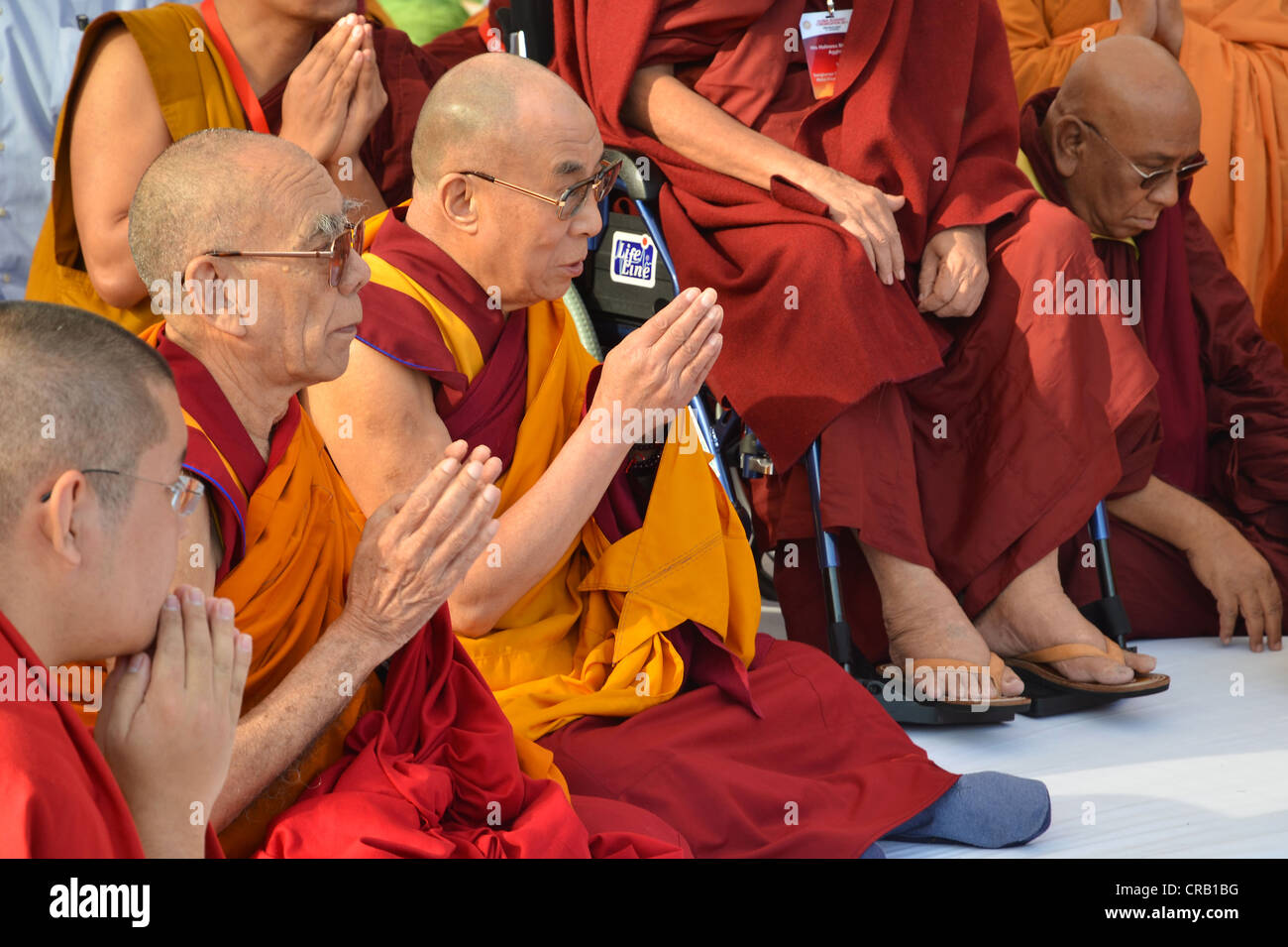 Buddhism, the Dalai Lama in a communal prayer with dignitaries, eg Karamapa, from all Buddhist branches and schools, - Stock Image