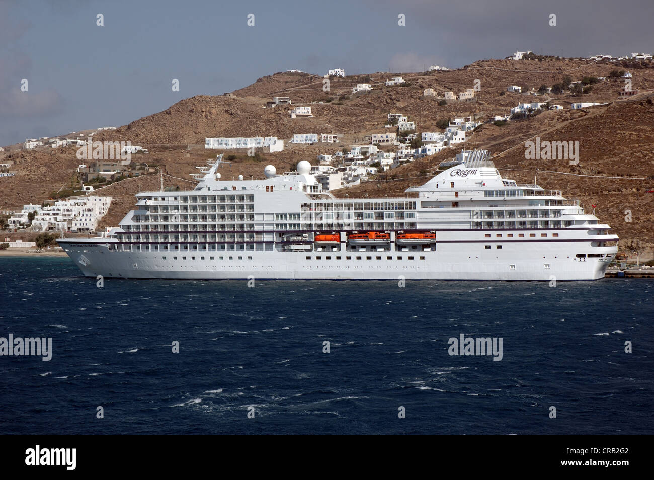 Regent Seven Seas Navigator moored in Mykonos, Greece - Stock Image