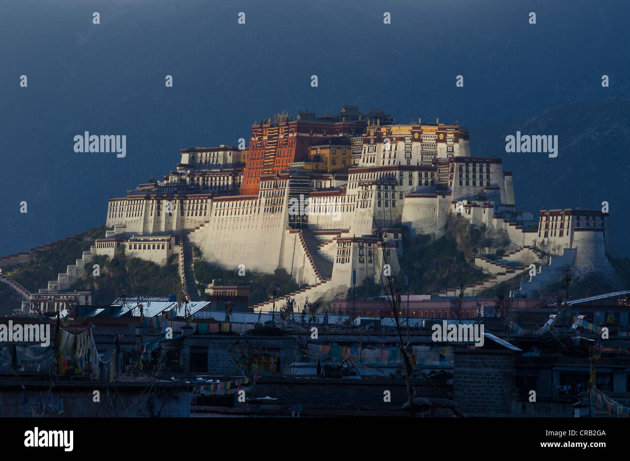 Potala Palace, winter palace of the Dalai Llama, above the roofs of the historic Tibetan district in Lhasa, Tibet, - Stock Image