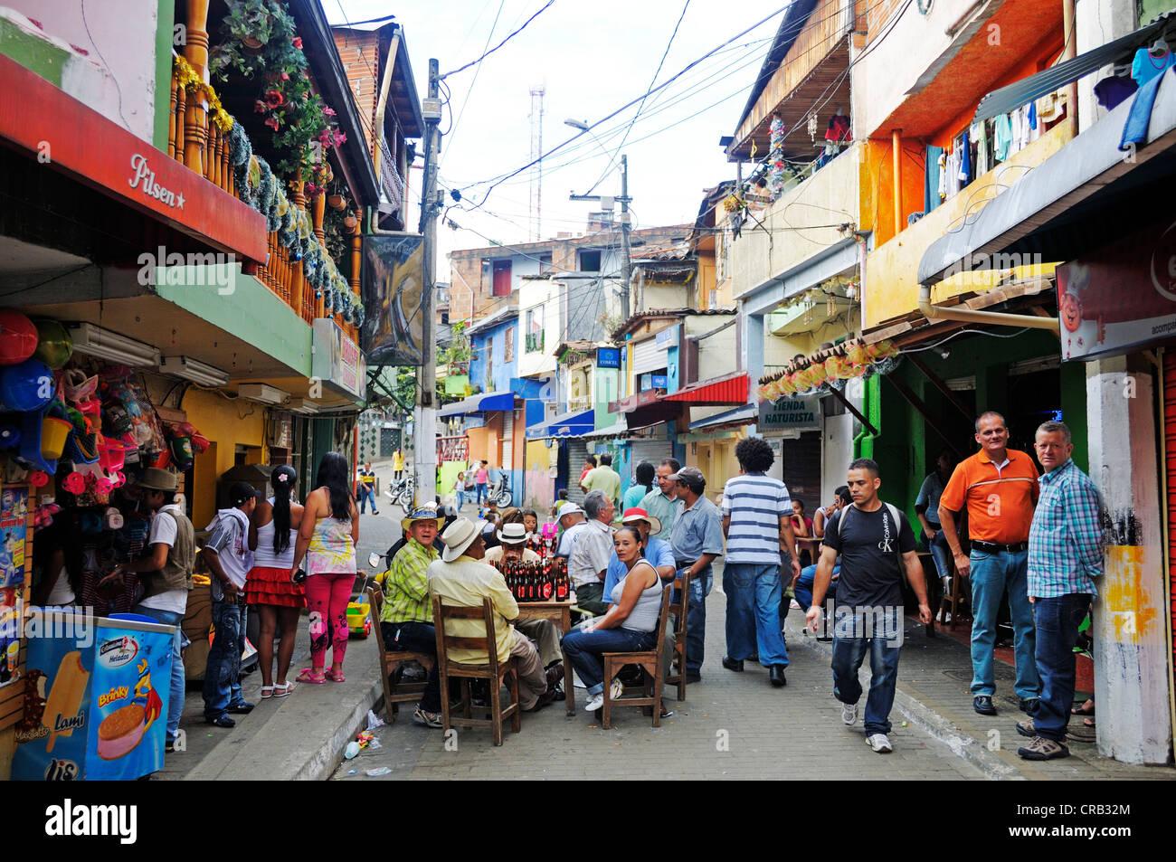 People celebrating in the streets, slums, Comuna 13, Medellin, Colombia, South America, Latin America, America - Stock Image