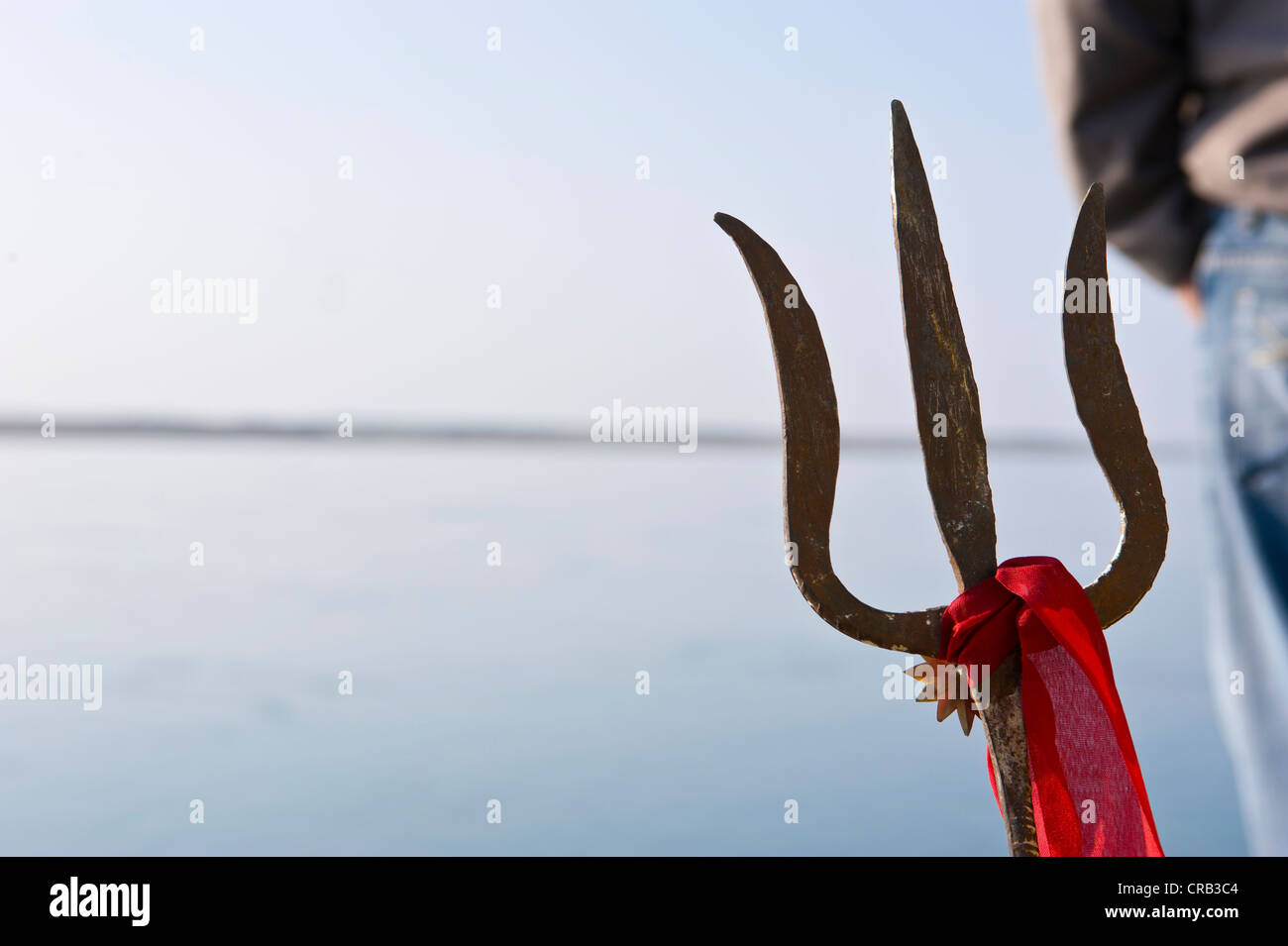 Trident of a sadhu, a holy man, alongside the Brahmaputra River, Assam, North East India, India, Asia - Stock Image