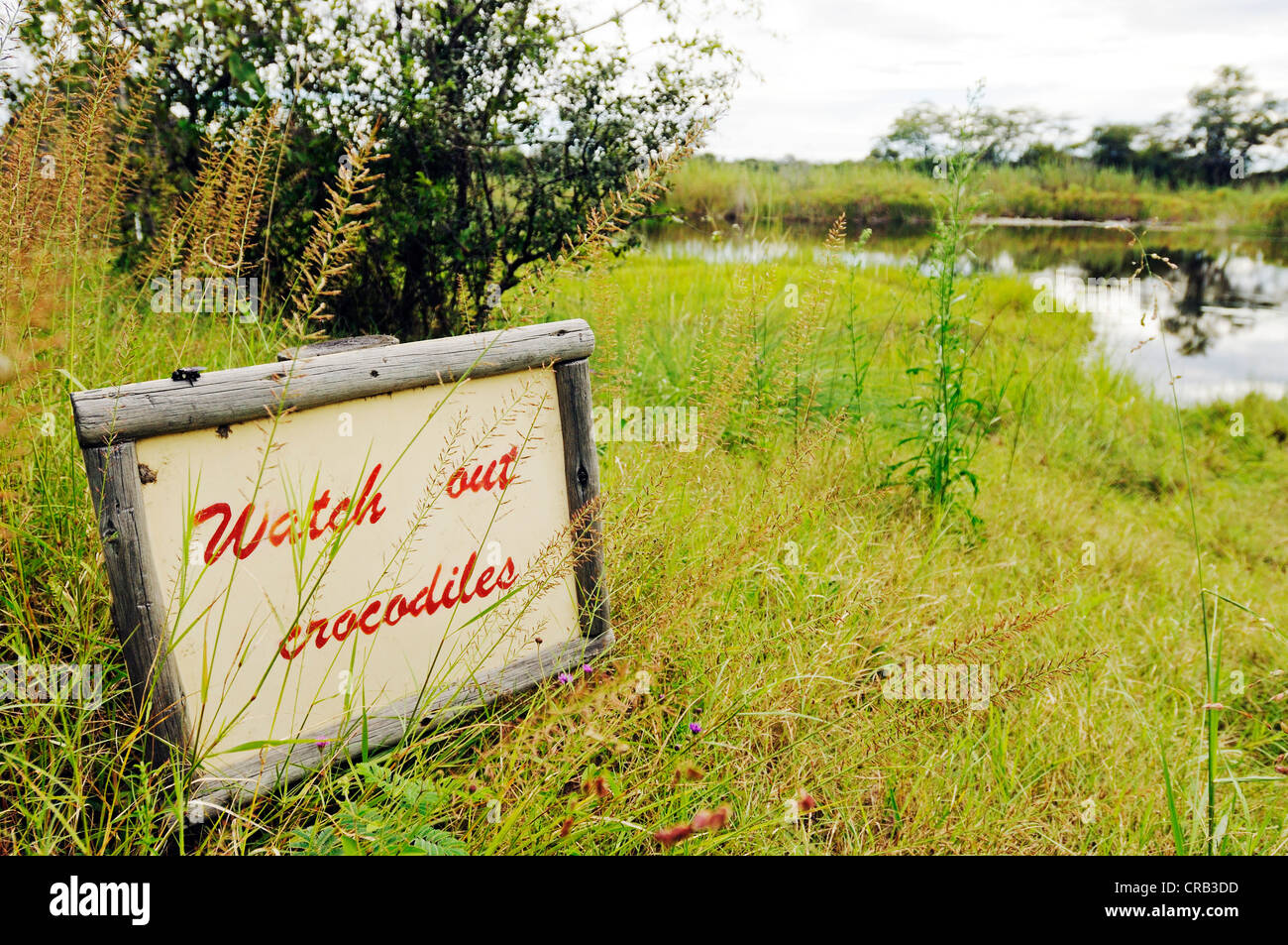 Sign 'Watch out, crocodiles', Camp Kwando, lodge and campground on the Kwando River, Caprivi Strip or Okavango - Stock Image