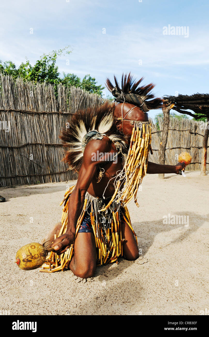 Healer or shaman dancing as a show for tourists, traditional village near Camp Kwando on the Kwando River - Stock Image