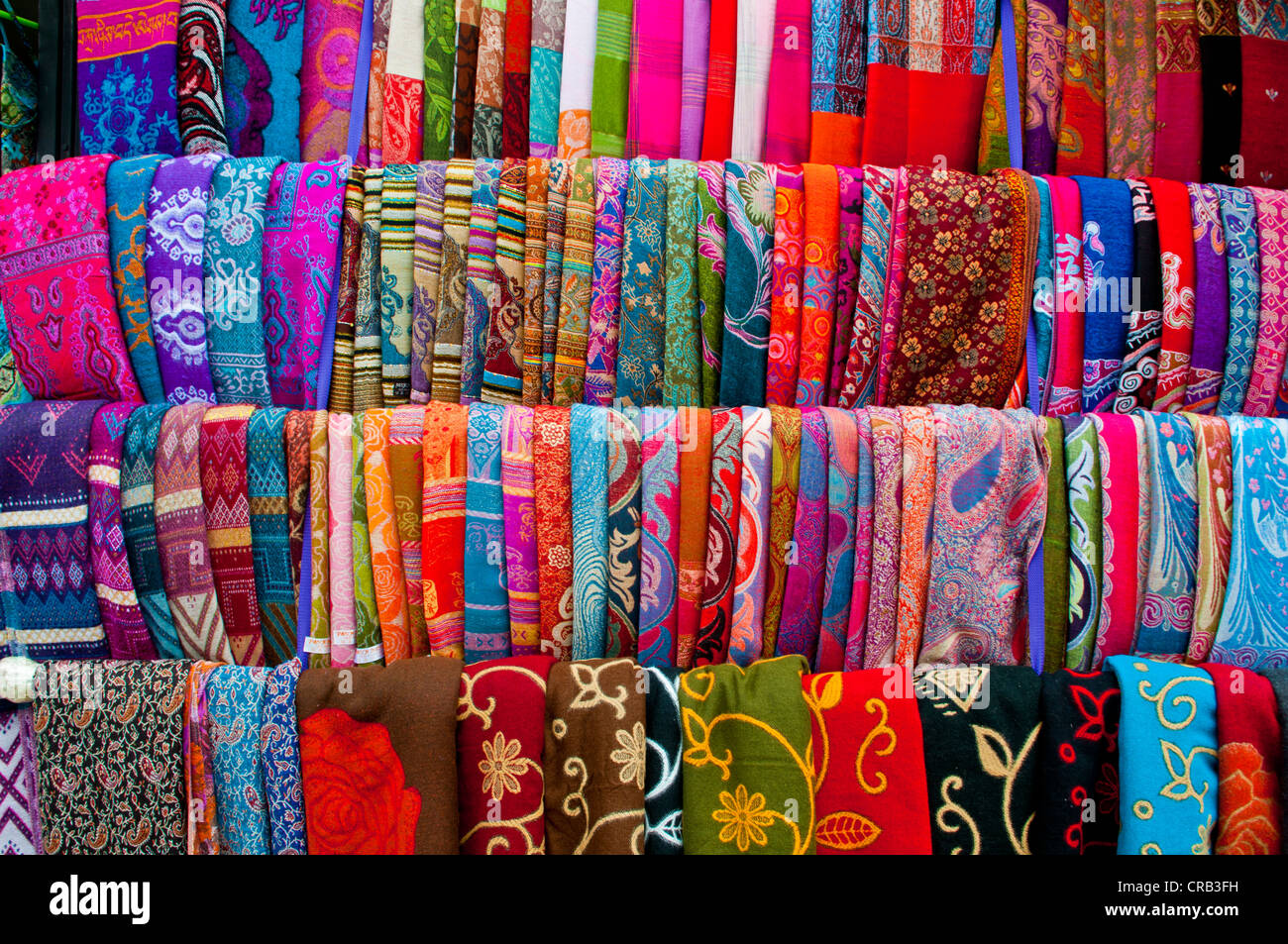 Colourful Tibetan garments for sale, Lhasa, Tibet, Asia - Stock Image