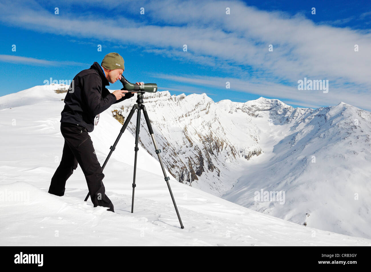 National Park Ranger looking through a spotting scope, Mount Schareck, National Park Hohe Tauern, Carinthia, Austria, - Stock Image