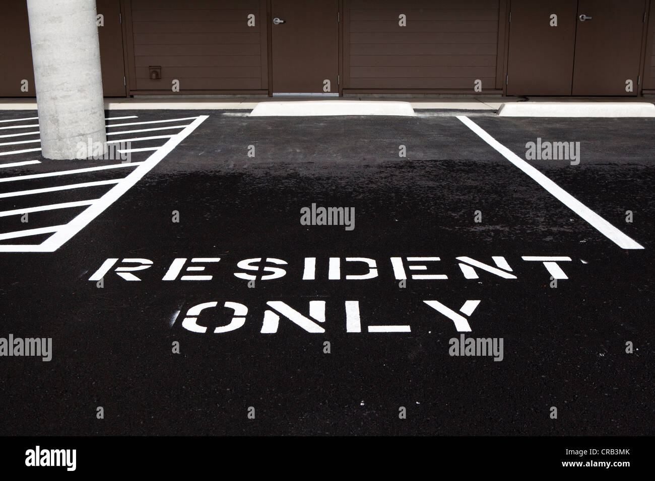 Resident only designated parking space. - Stock Image