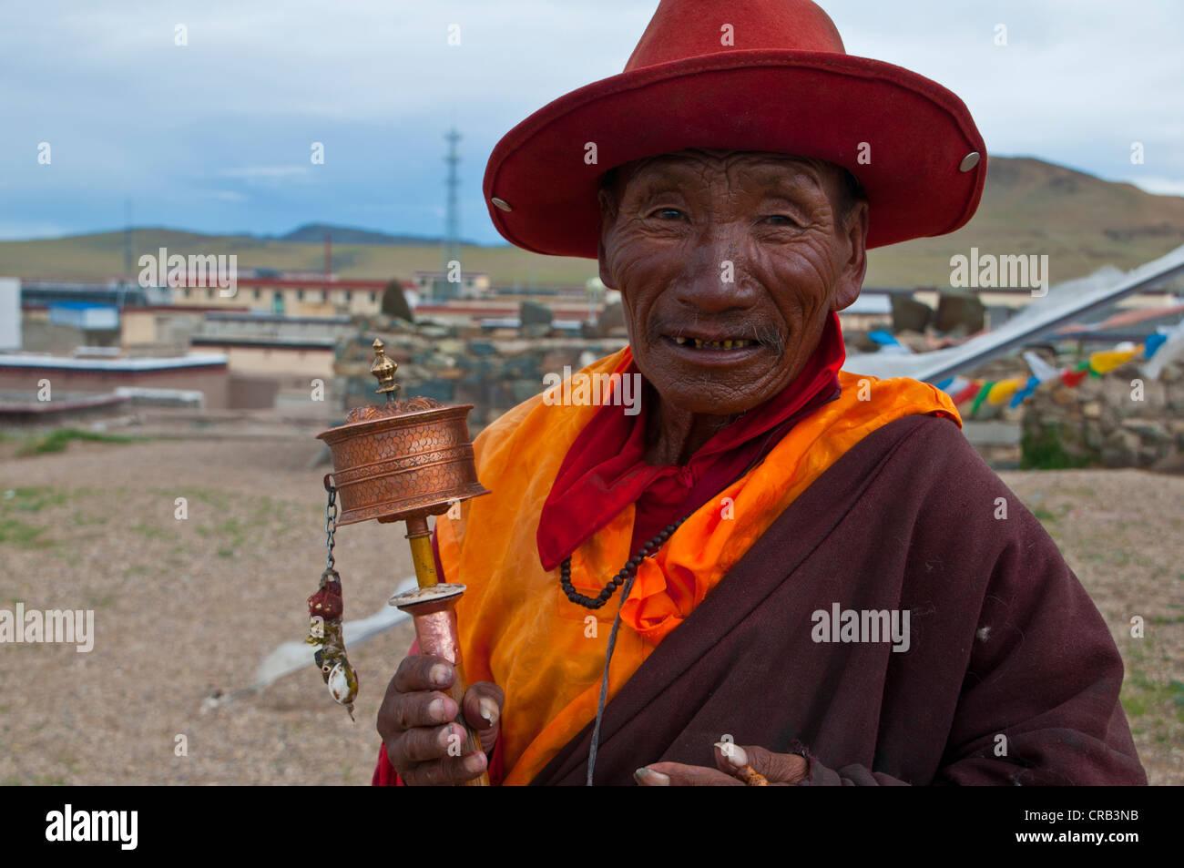 Elderly monk in the town of Tsochen, Western Tibet, Tibet, Asia - Stock Image