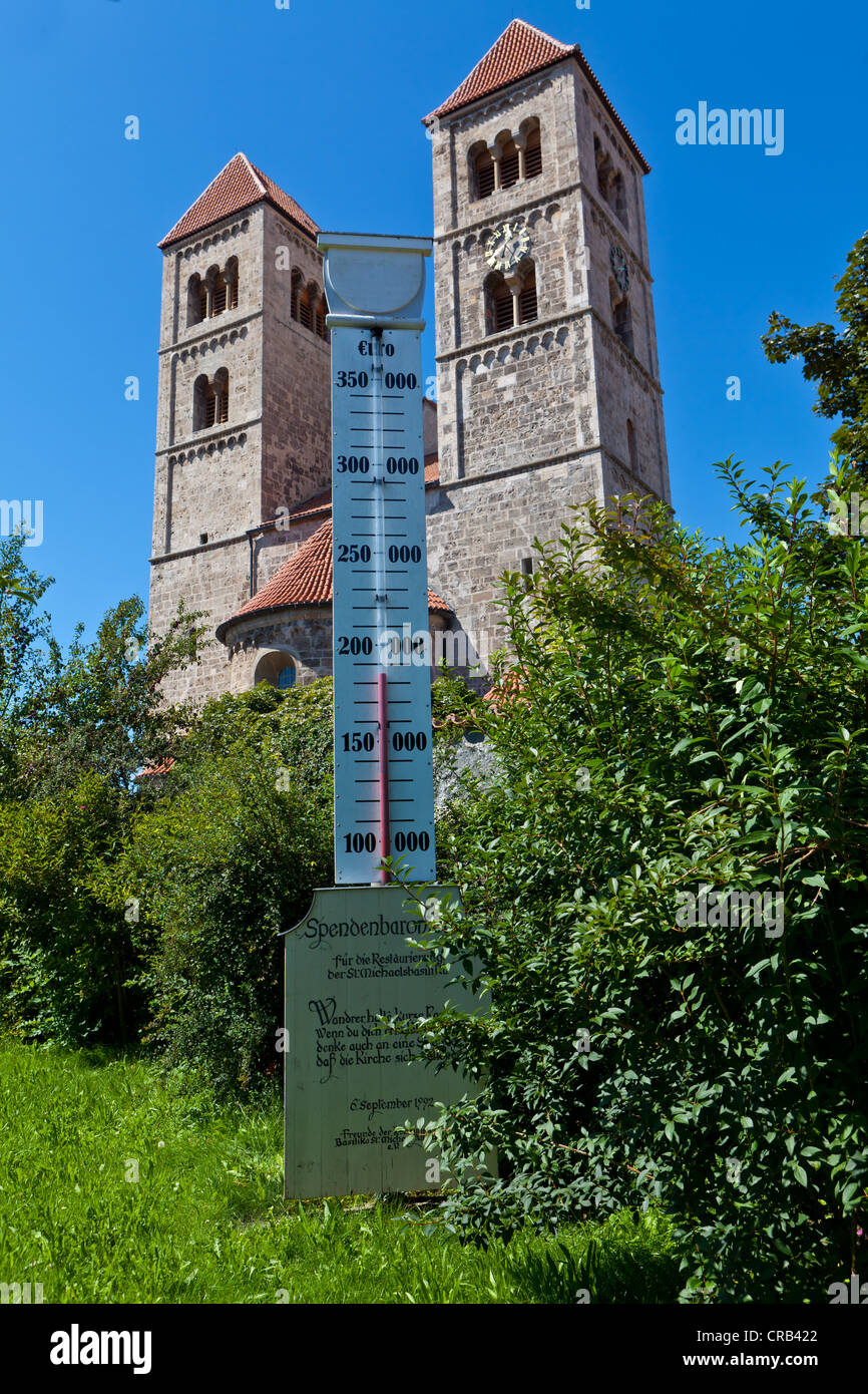 Fund raising or donations barometer in front of St. Michael's basilica, 1180, late Romanesque tufa stone building, - Stock Image