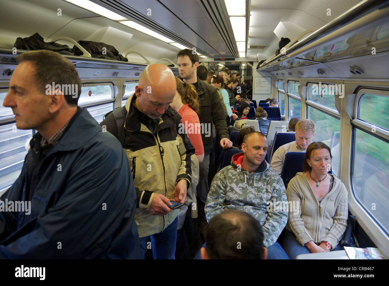 A crowded commuter train on the way to London, England - Stock Image