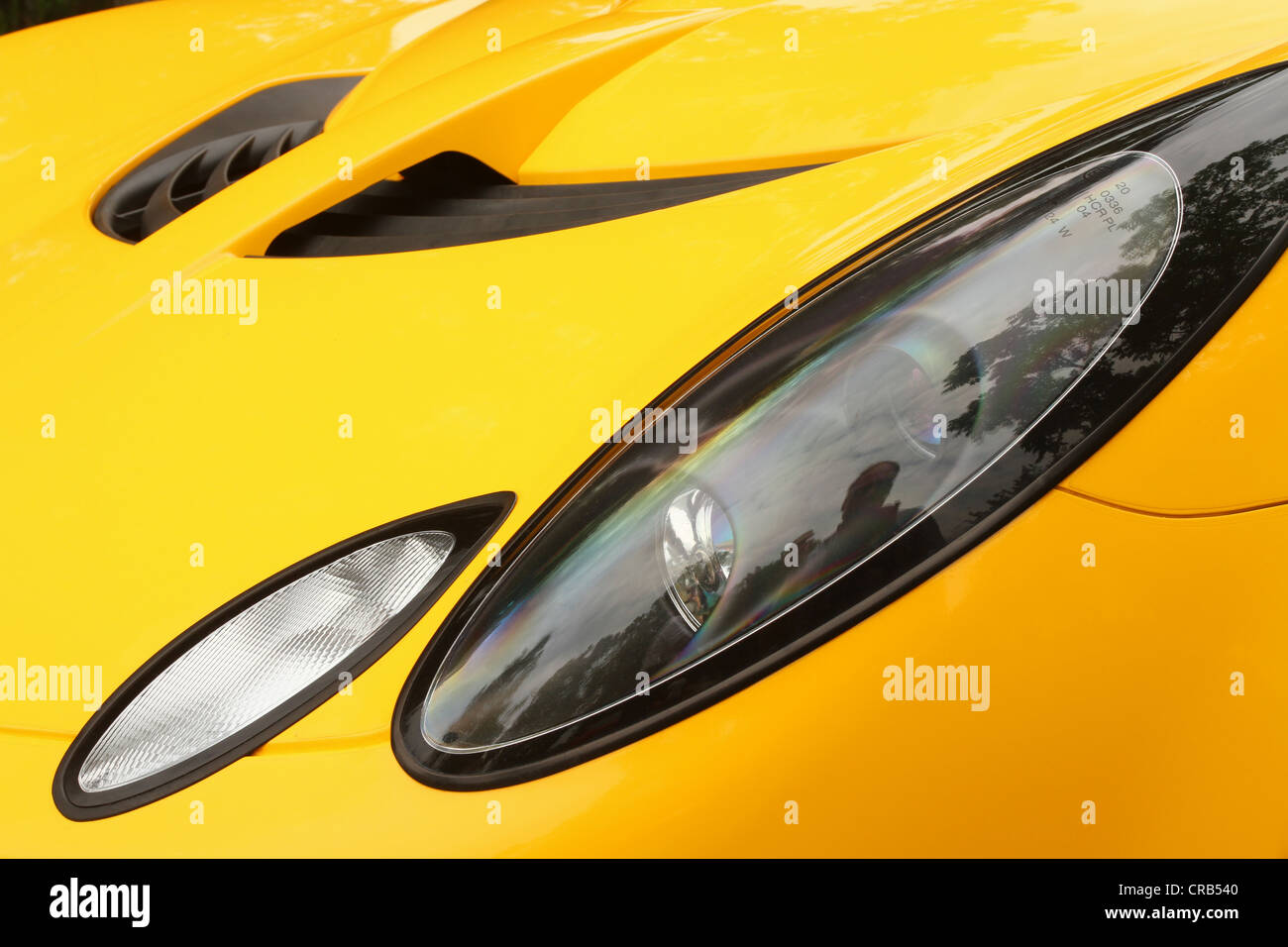 Auto- Yellow Lotus Elise TS. Sports Car Front Lights. - Stock Image