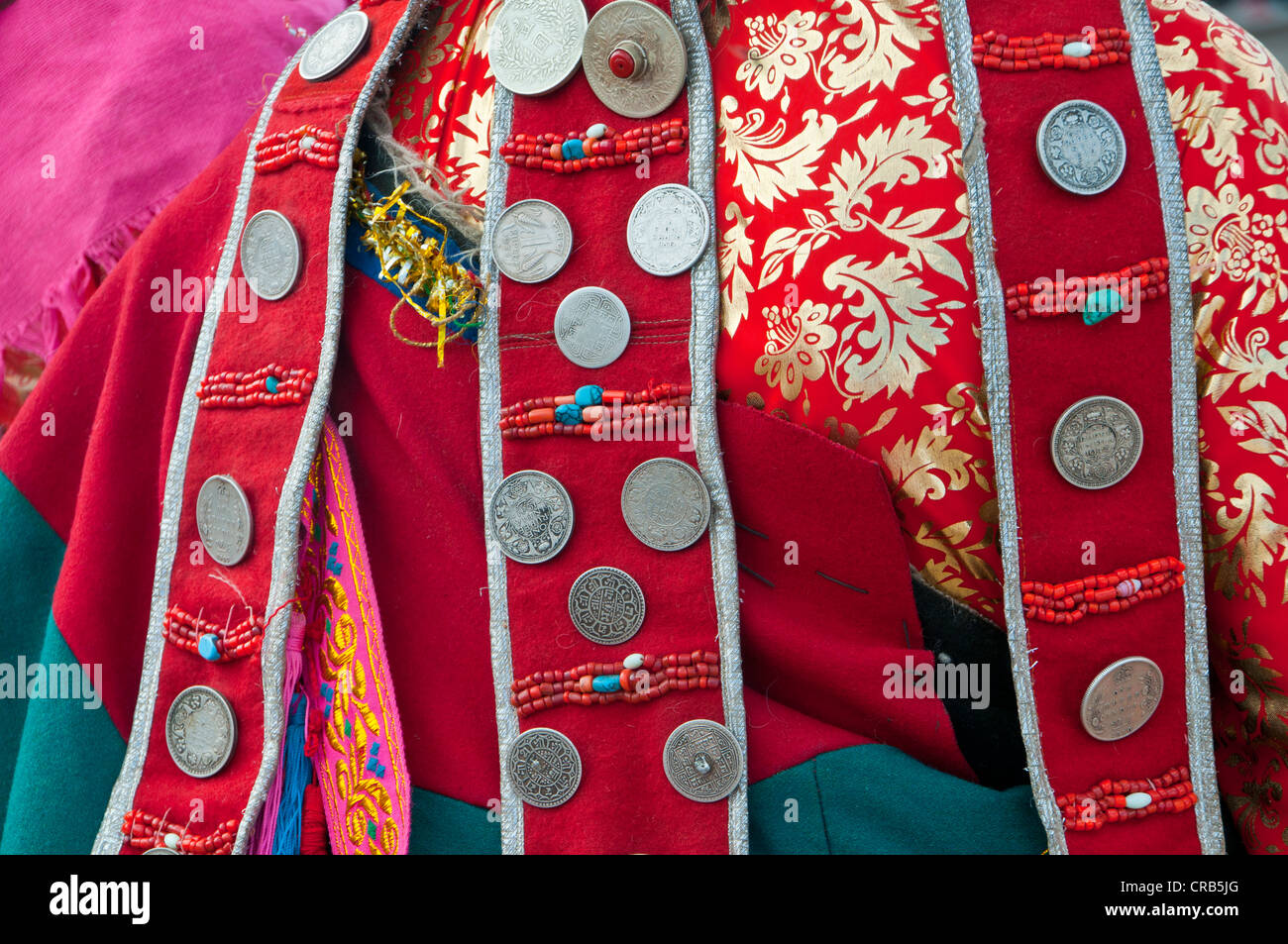 Close up of traditional clothes on the festival of the tribes in Gerze, Western Tibet, Asia - Stock Image