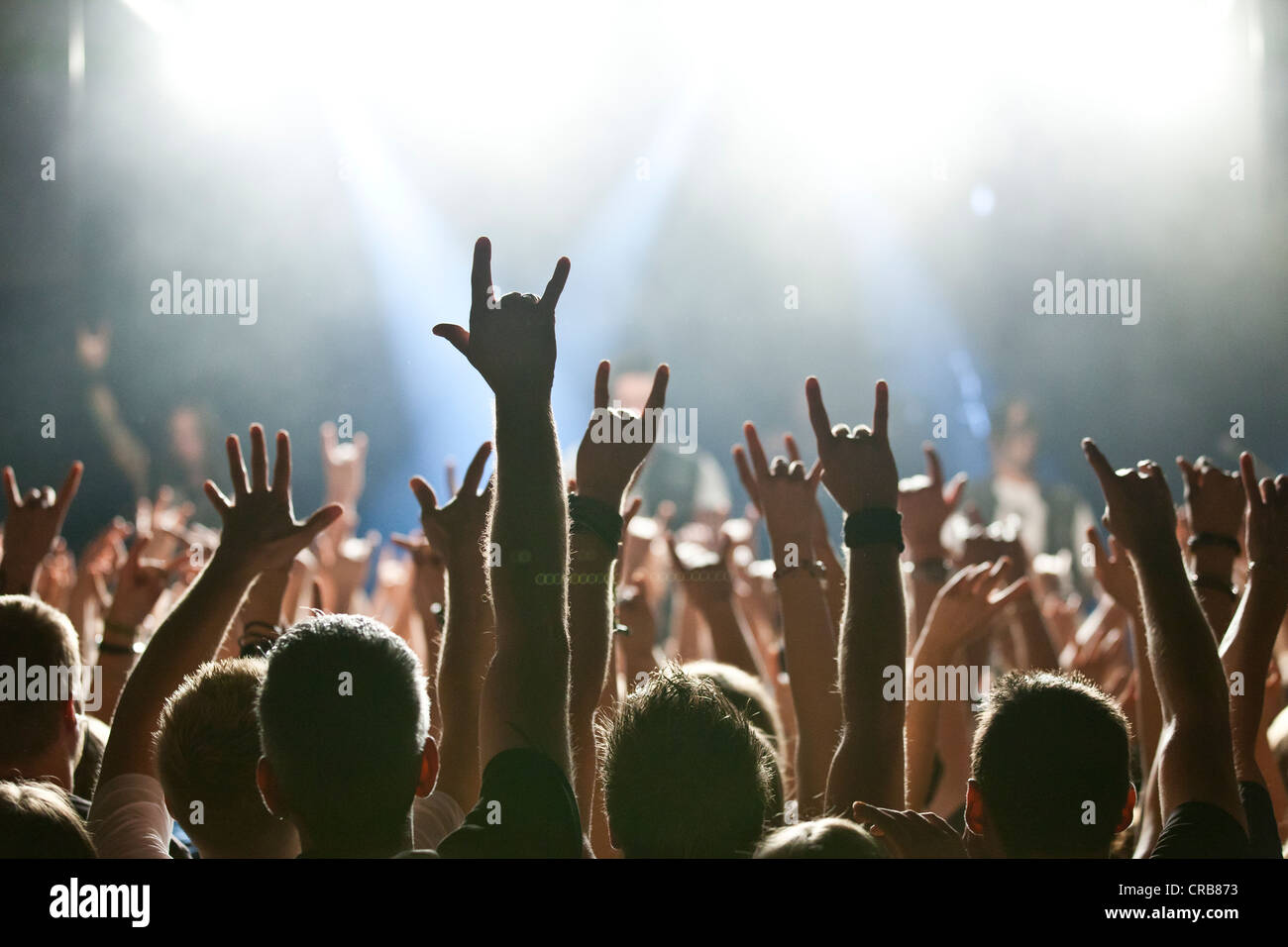 Rocker greeting from fans at rock concert - Stock Image