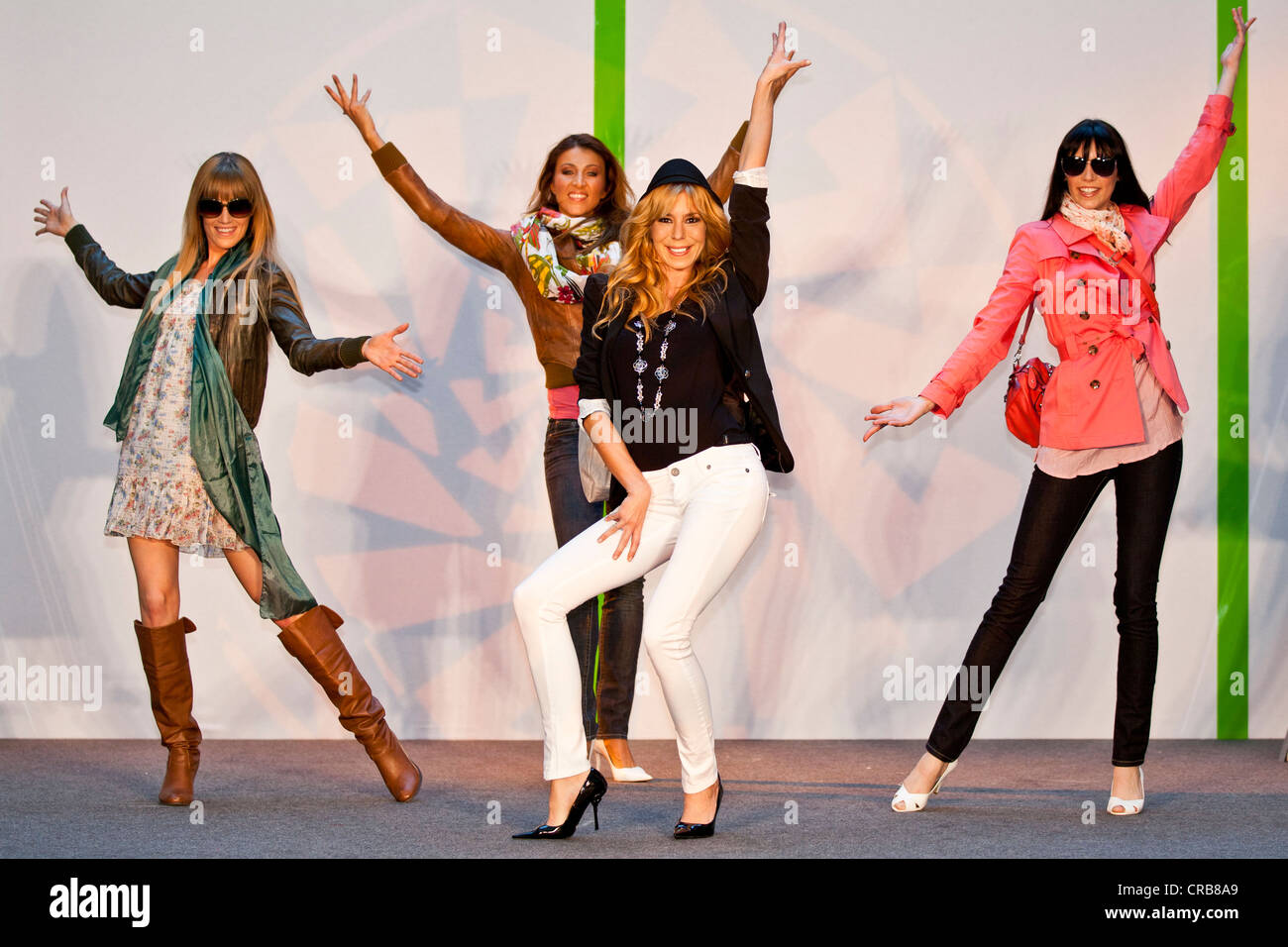 Four female models posing on stage - Stock Image
