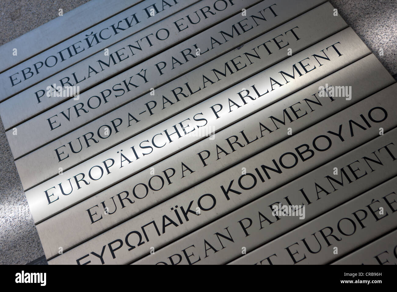 German reference to the European Parliament on multilingual sign, Euro-City, Brussels, Belgium, Europe - Stock Image
