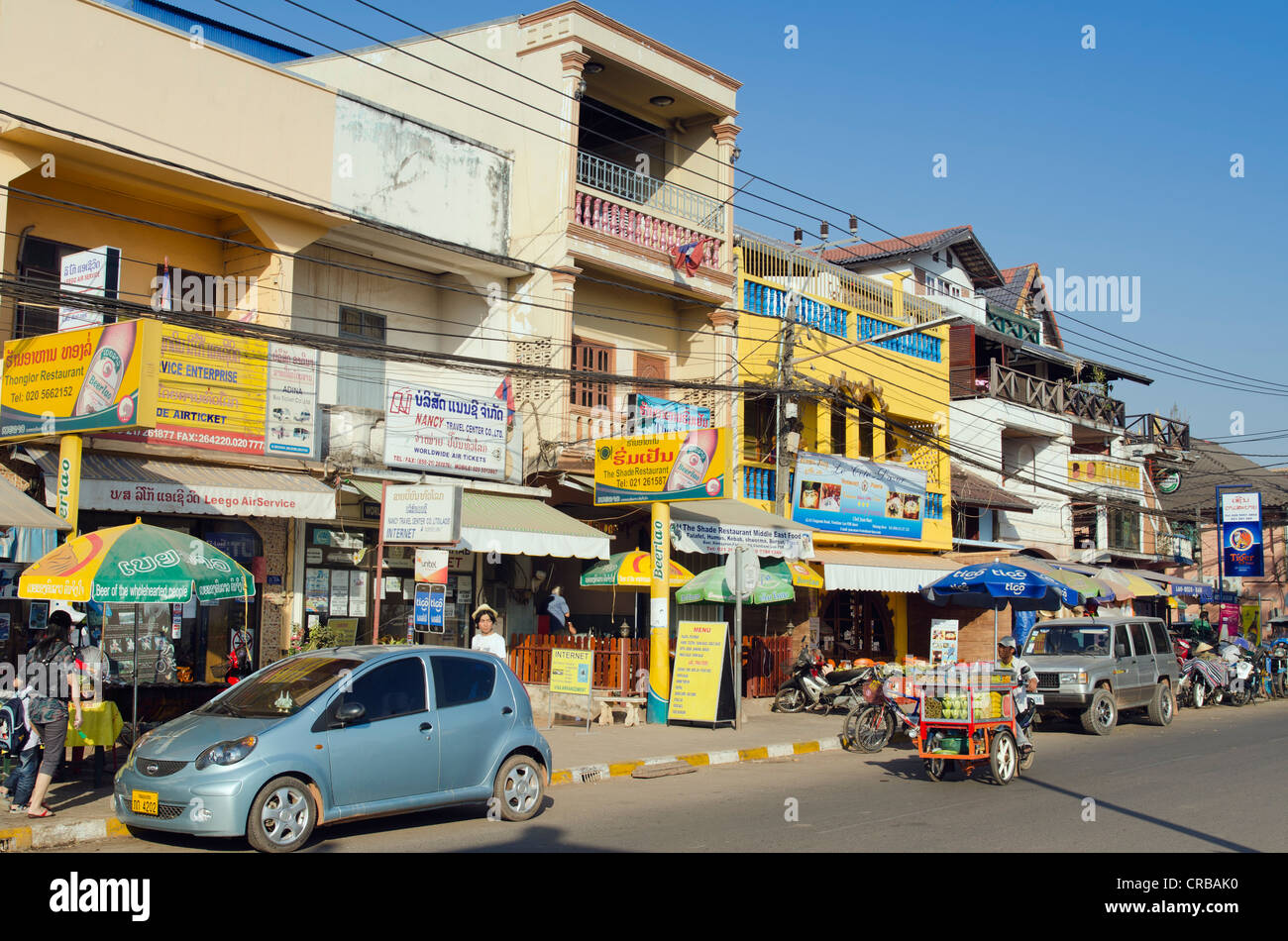 Traffic, shops and restaurants, Fa Ngum Road, Vientiane, Laos, Indochina, Asia - Stock Image