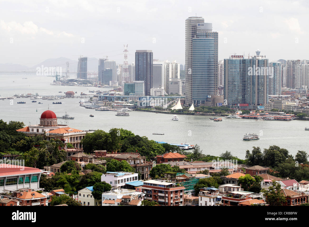 View of the skyline of Xiamen as seen from Gulangyu Island, Xiamen, also known as Amoy, Fujian province, China, - Stock Image