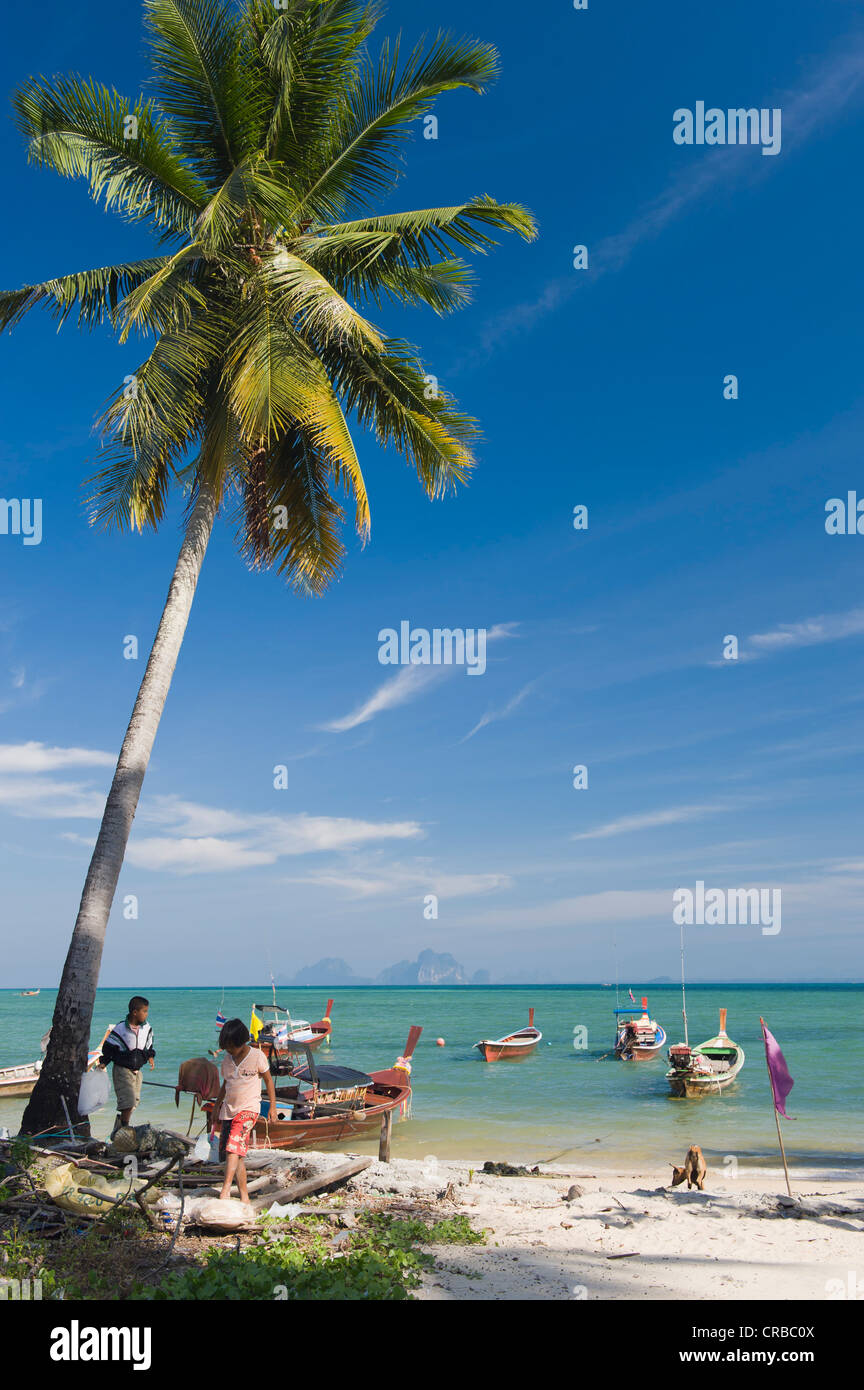 Children playing on the beach in the fishing village, Ko Muk or Ko Mook island, Thailand, Southeast Asia Stock Photo