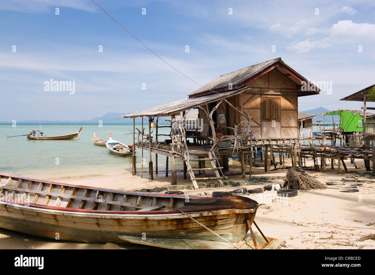 fishermans-house-on-stilts-long-tail-boat-fishing-village-ko-muk-or-CRBCED.jpg