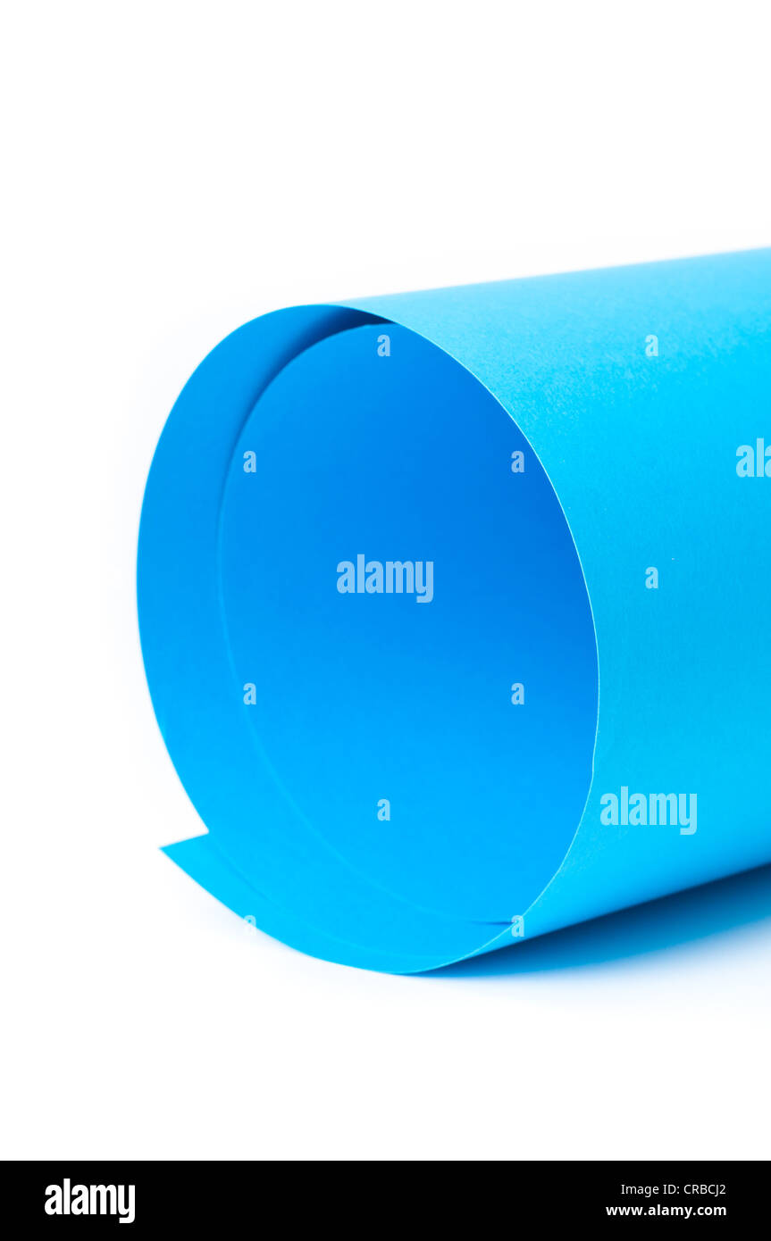 blue paper on rolled background - Stock Image