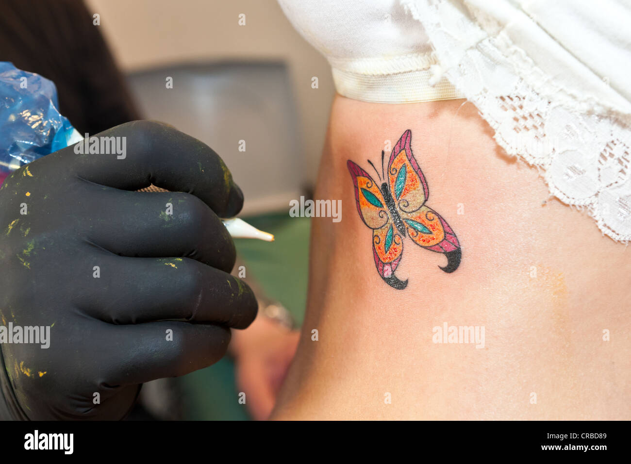 Finished tattoo of a butterfly - Stock Image