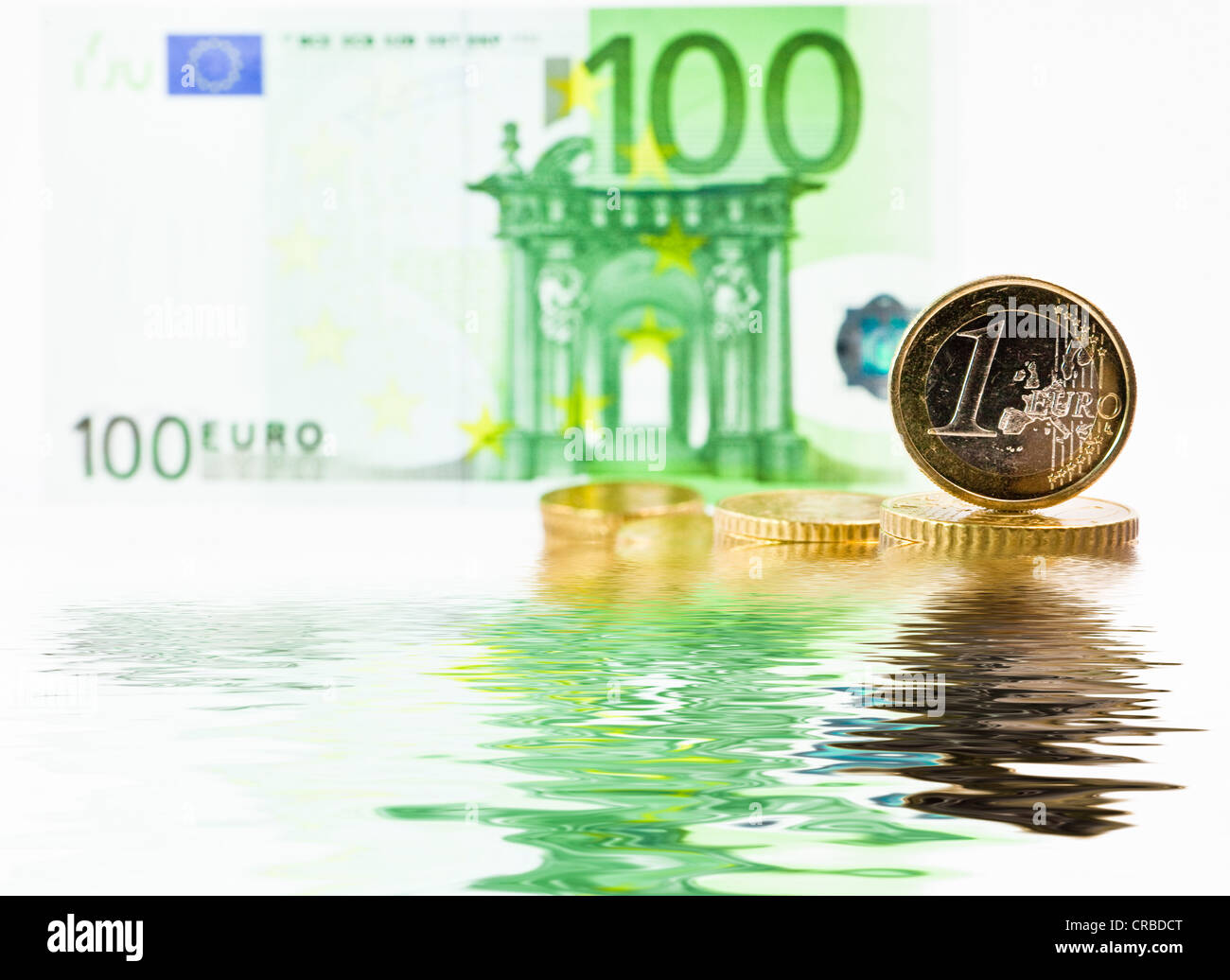 Euro note and euro coin, water, symbolic image for the dilution of the euro, decline in the value of the euro - Stock Image