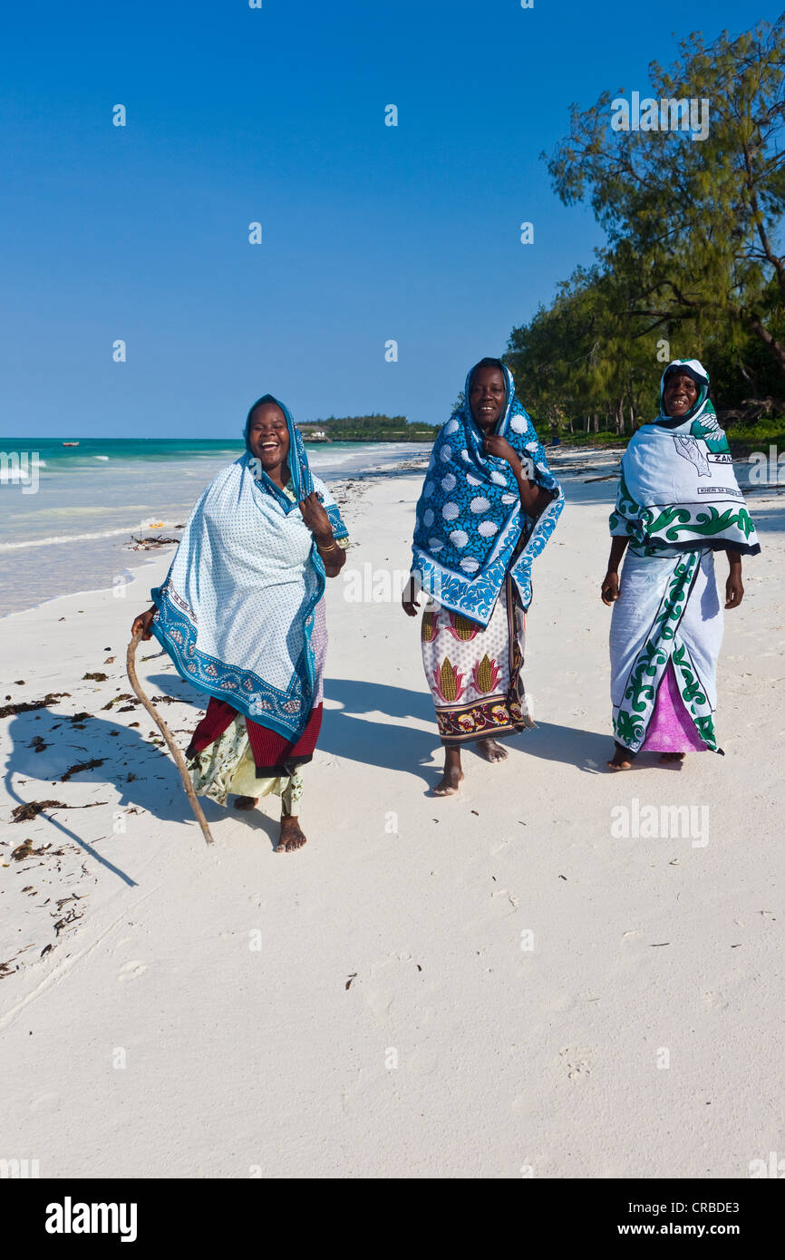 Muslim women on the beach in Zanzibar, Tanzania, Africa