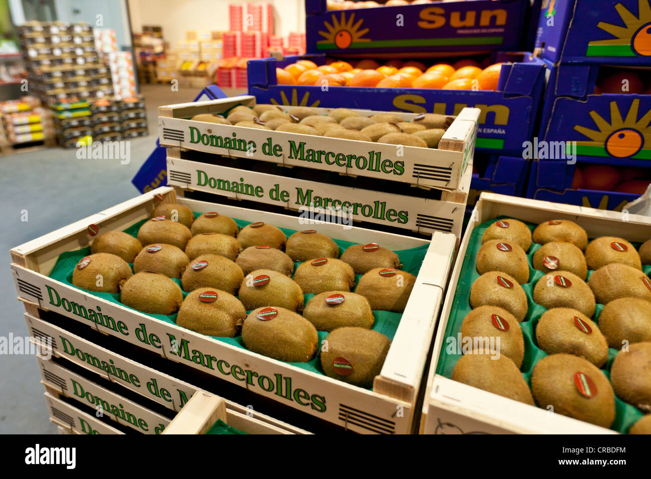 Fresh kiwi fruit in wooden crates in the wholesale for fresh