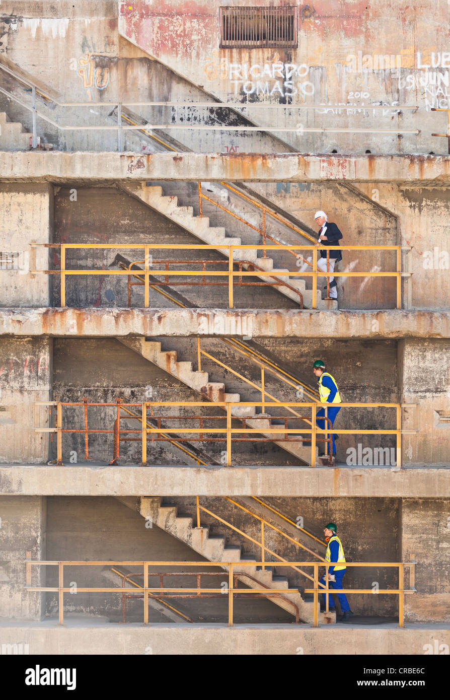 Workers climbing steps on dry dock Stock Photo