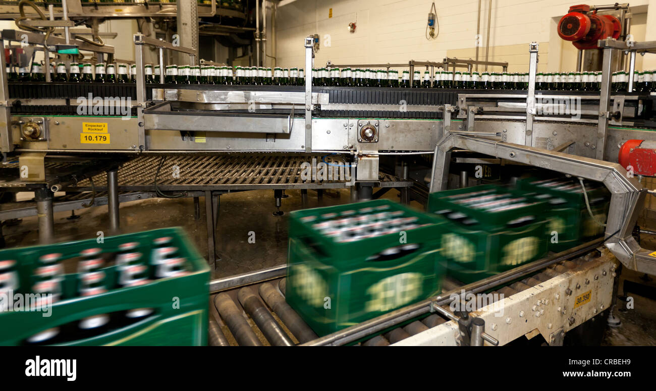 Filled beer crates on a conveyor belt with motion blur, Binding brewery, Frankfurt, Hesse, Germany, Europe - Stock Image
