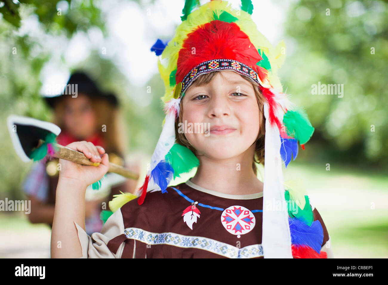 Boy wearing Indian costume outdoors - Stock Image
