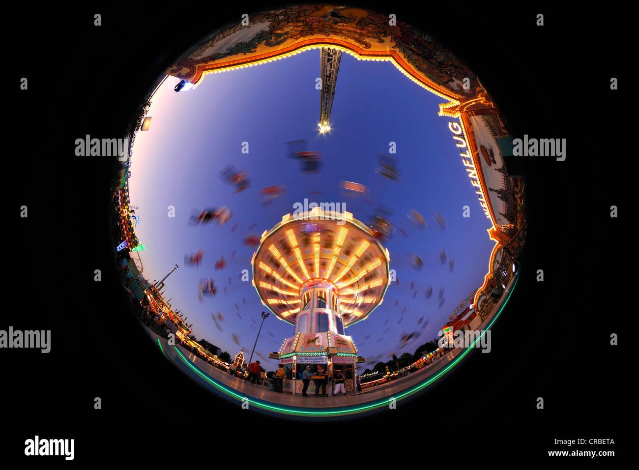 Night scene, fisheye shot, Chair-O-Planes or swing carousel, Cannstatter Volksfest, Wasen, Stuttgart Beer Festival - Stock Image