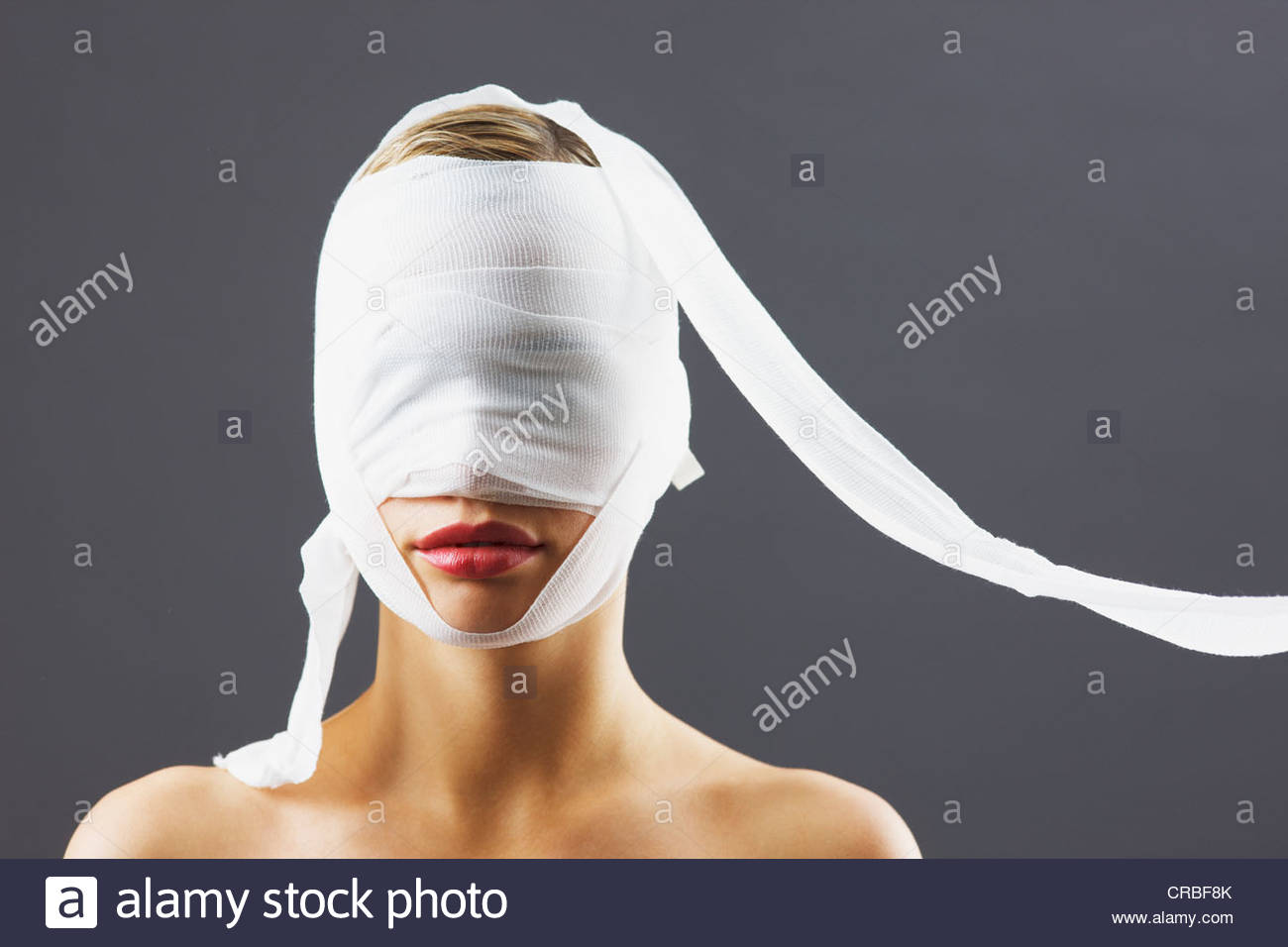 Bandage covering woman's face - Stock Image