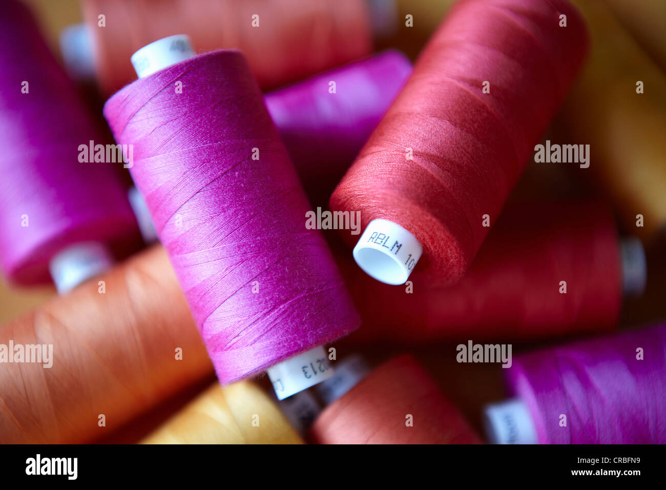 Close up of colorful spools of thread - Stock Image
