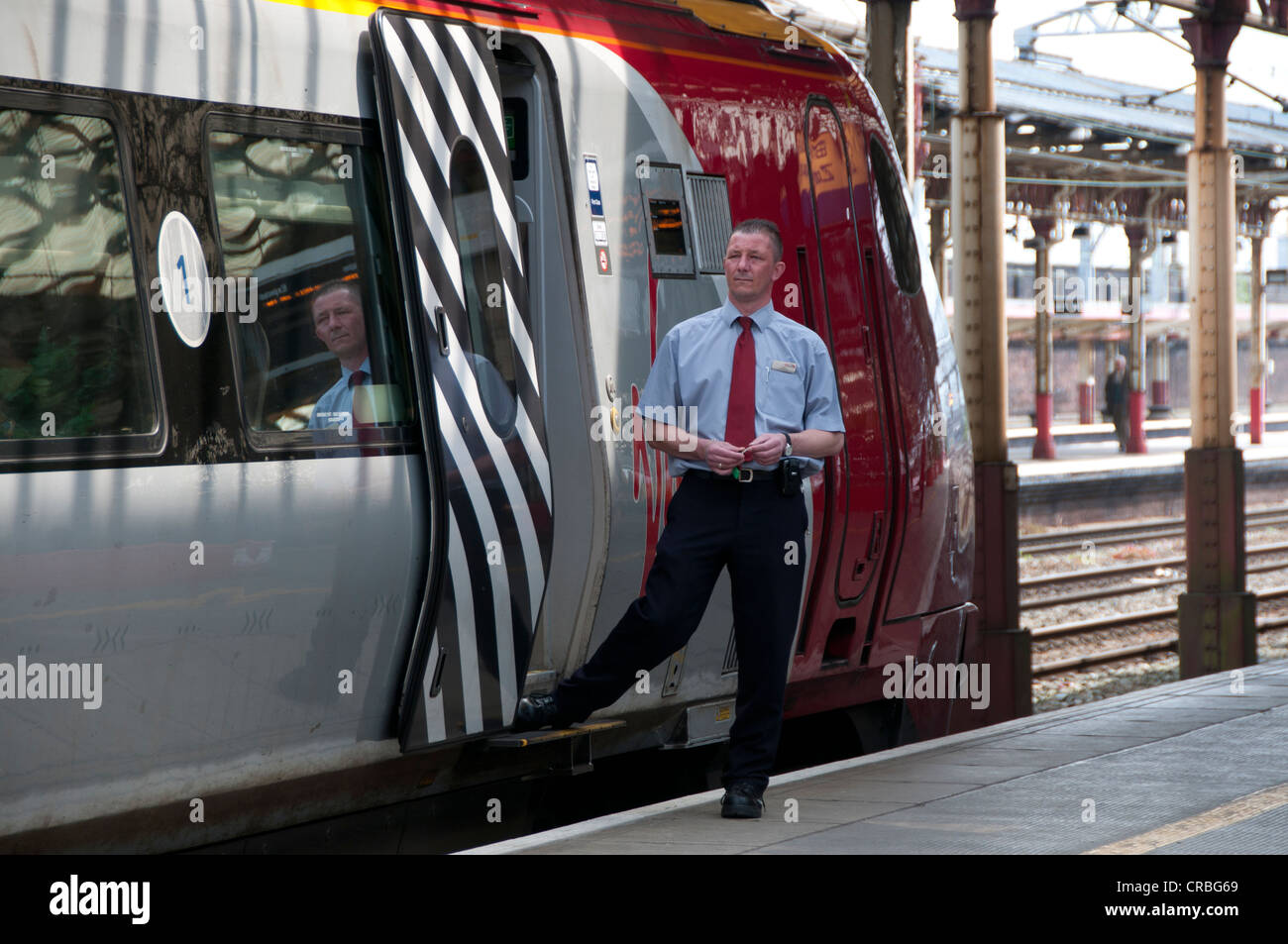 Crewe station. Virgin train and driver waiting to depart - Stock Image