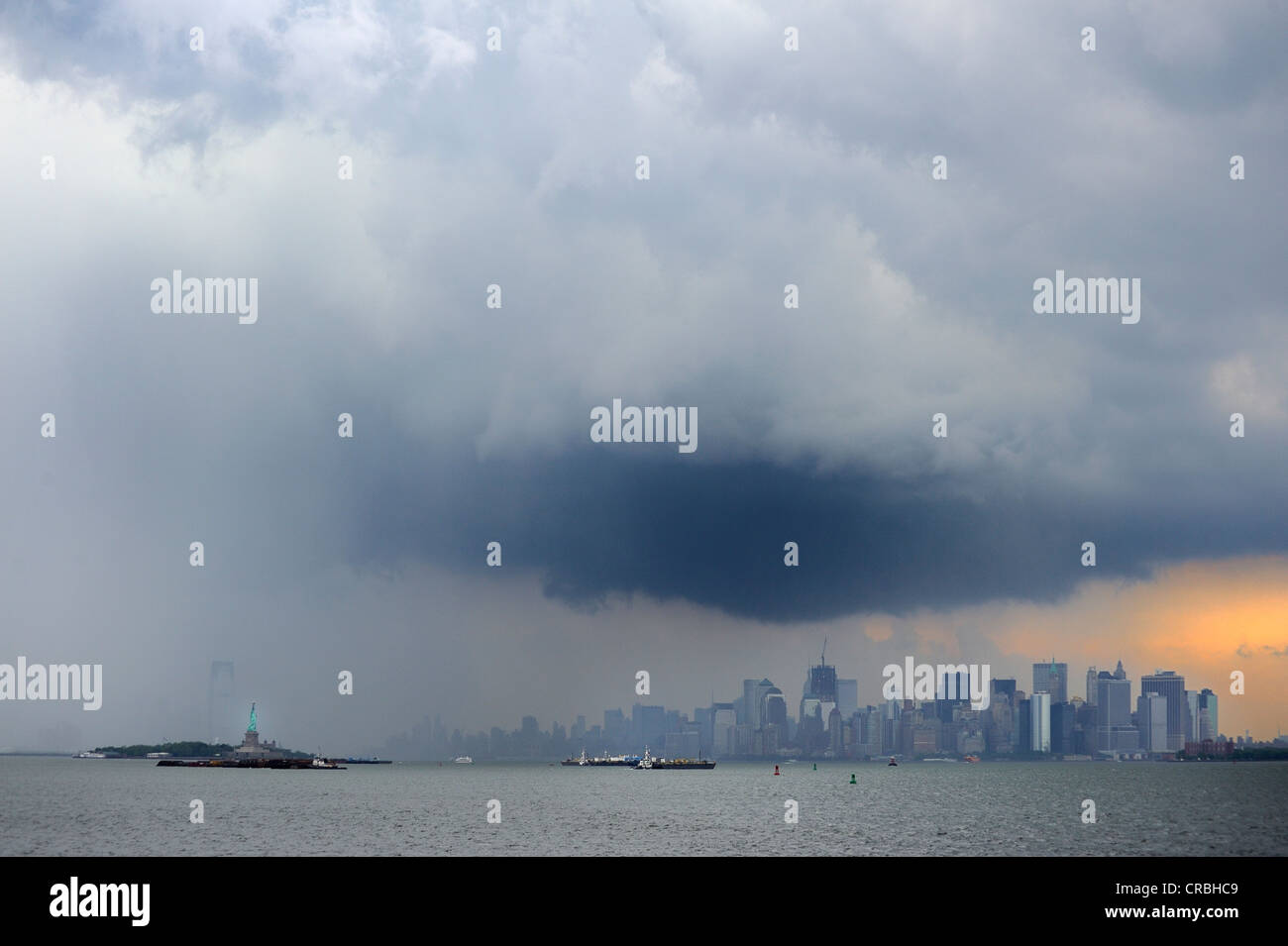 Dark clouds and thunderstorms over Manhattan, New York, USA - Stock Image