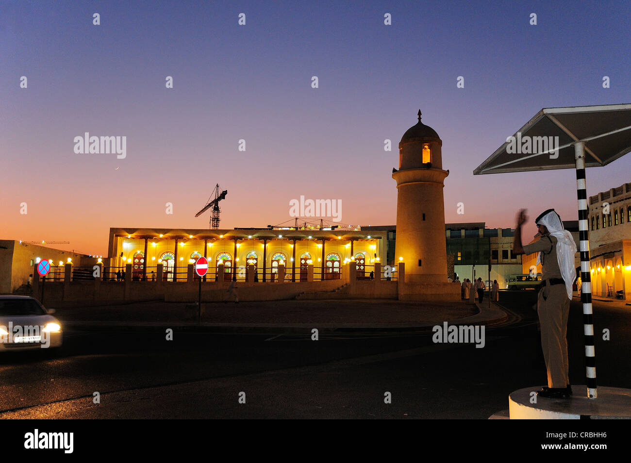Police officer directing traffic outside the mosque in the Souk Waqik, Doha, Qatar - Stock Image