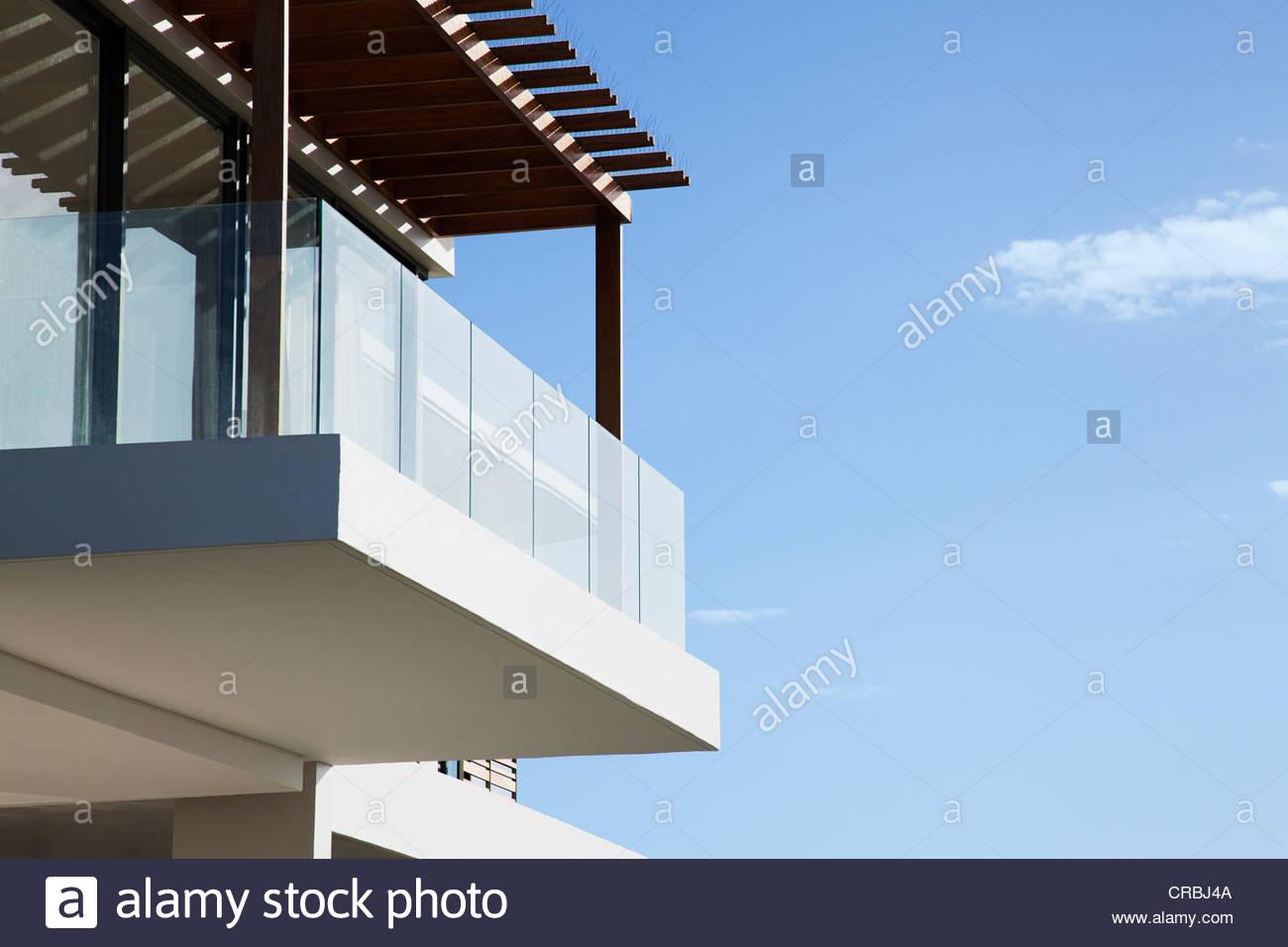 Glass balcony on modern house - Stock Image