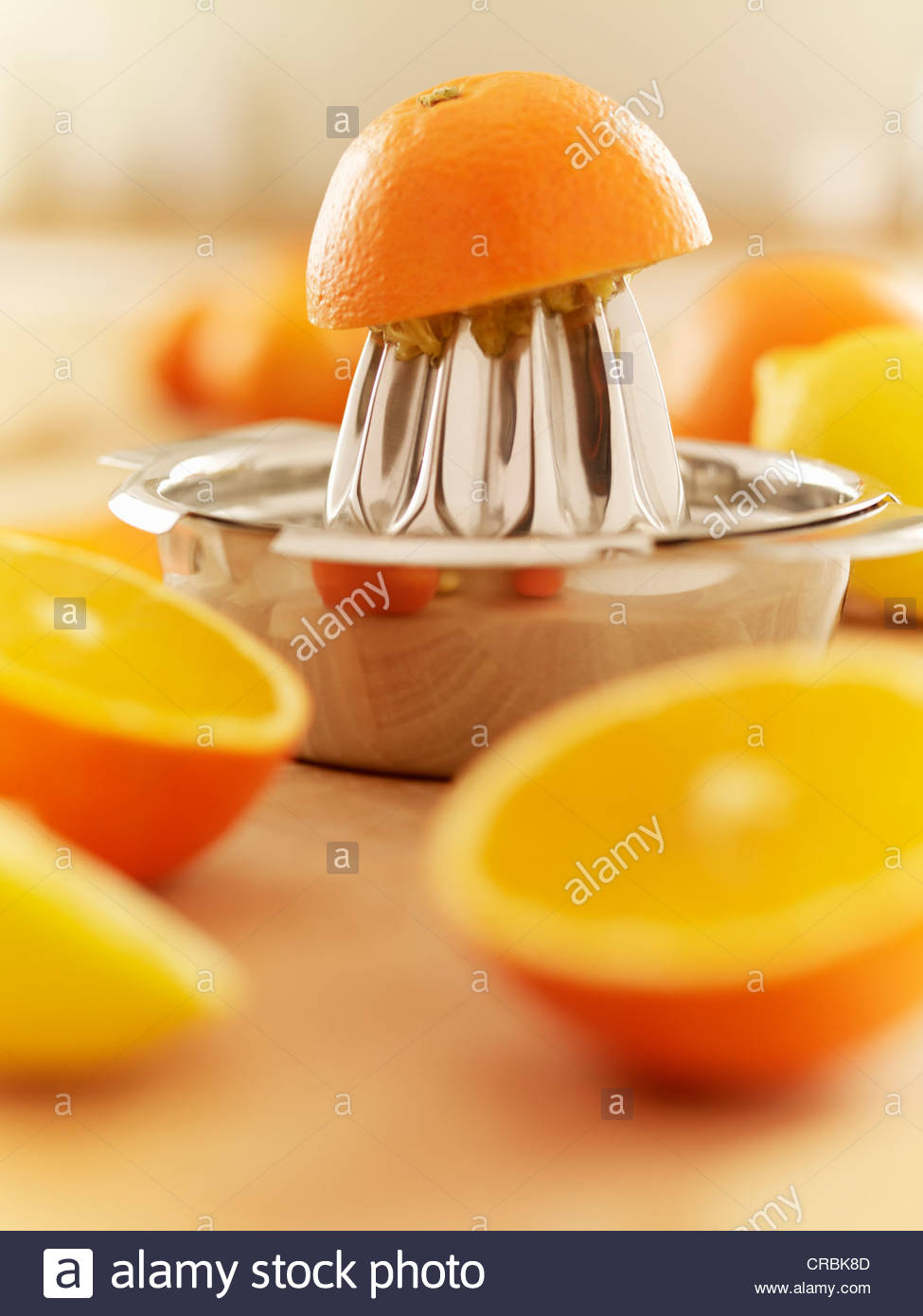 Oranges and juicer Stock Photo