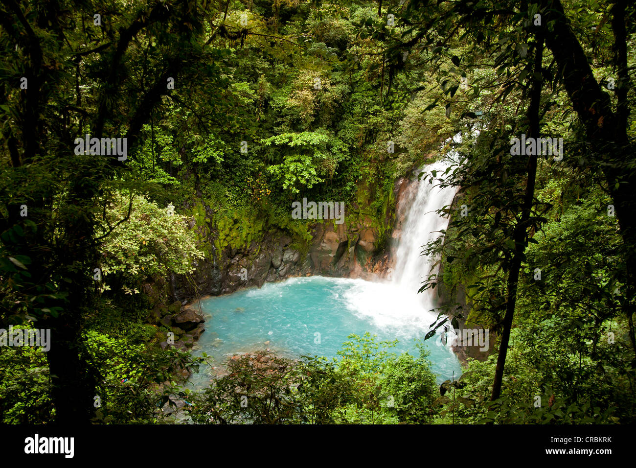 Waterfall with the blue waters of the Rio Celeste in Volcán Tenorio National Park, Costa Rica, Central America Stock Photo