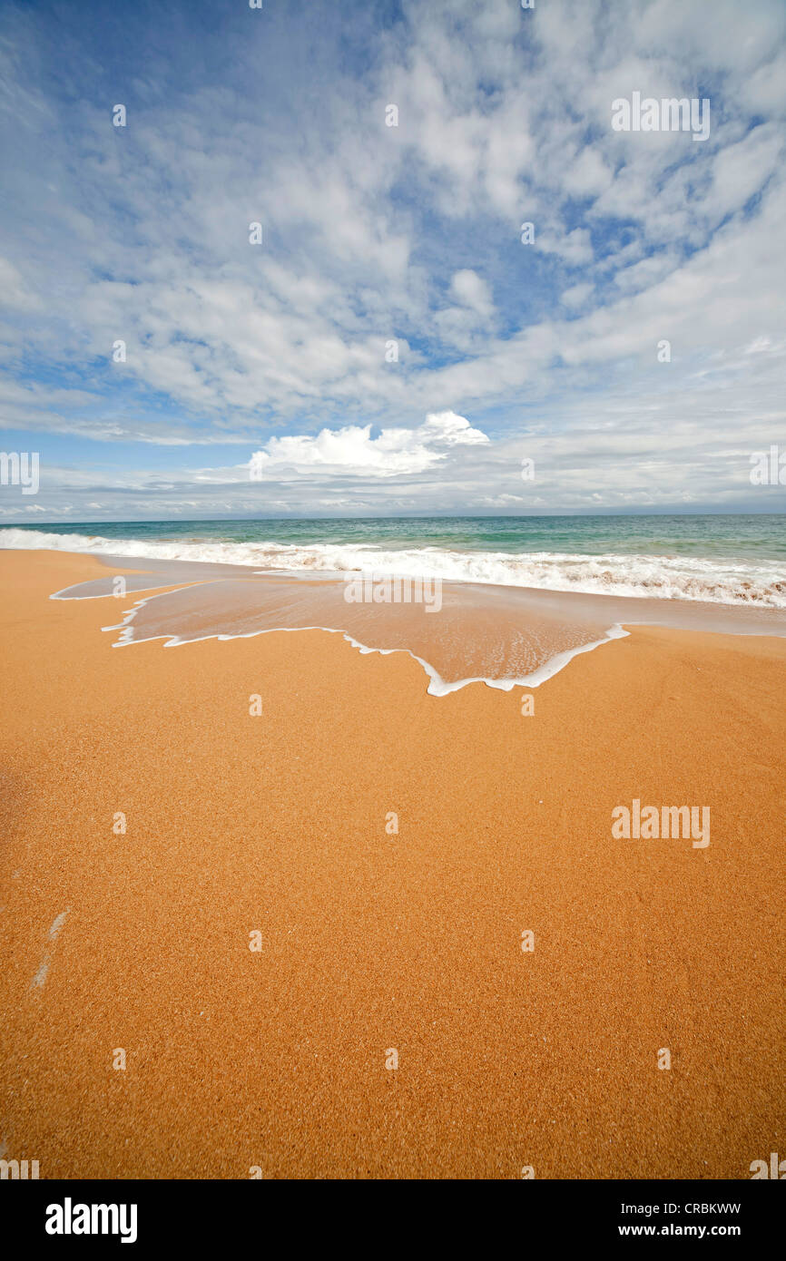 Surf on the sandy beach of Bluff Beach on the island of Colon, Bocas del Toro, Panama, Central America - Stock Image