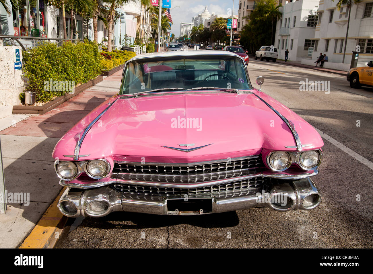 Pink Cadillac in the Art Deco district of South Beach, Miami, Florida, USA - Stock Image