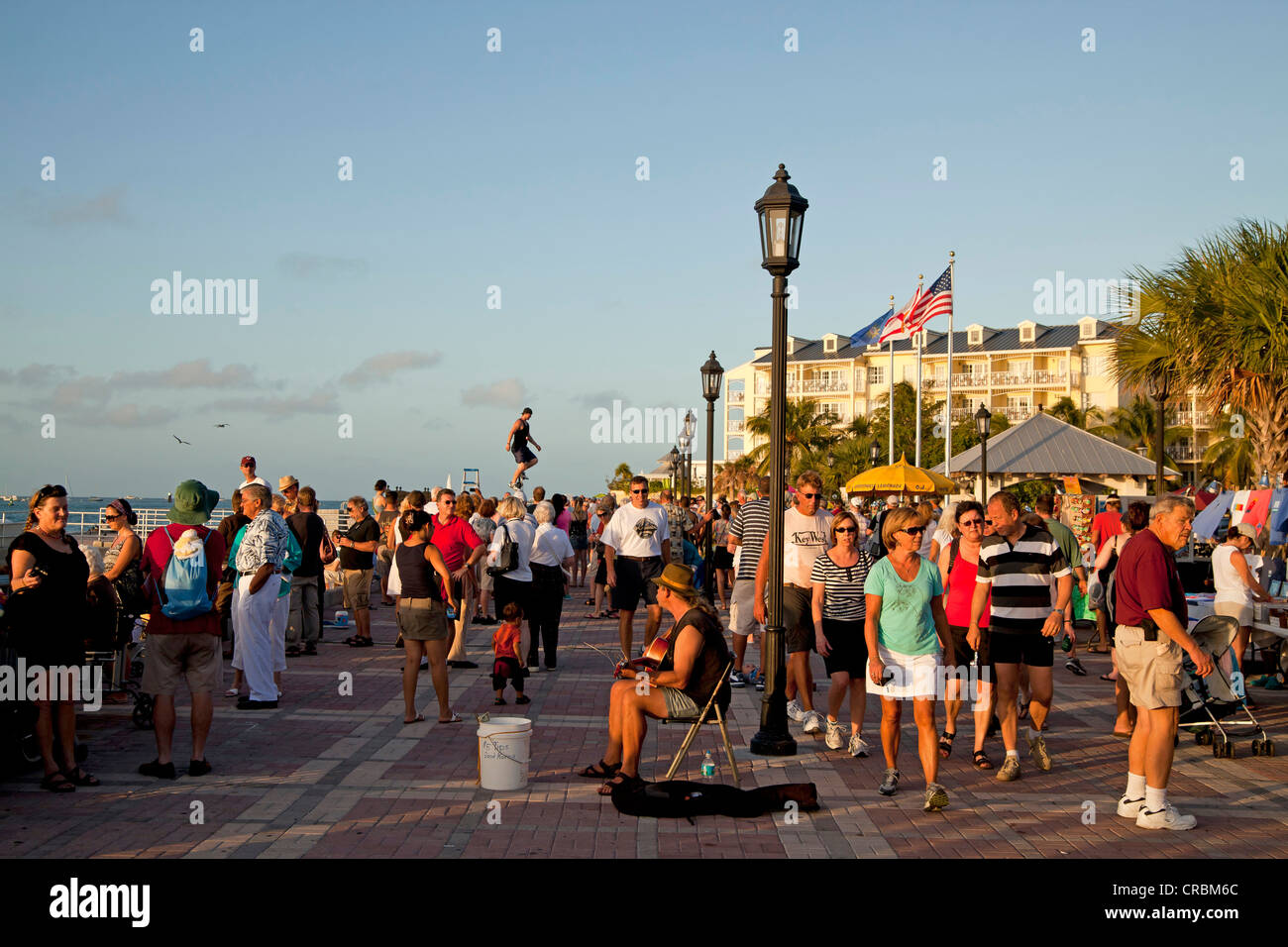 Street performer and pedestrians on Mallory Square in Key West, Florida Keys, Florida, USA - Stock Image