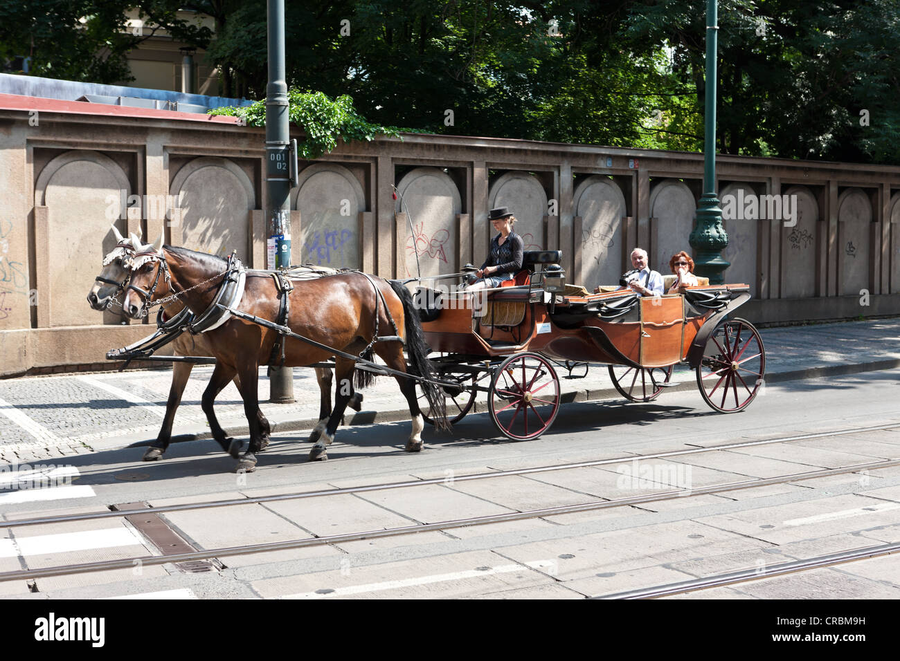 Horse carriage driving tourists through Prague, Czech Republic, Europe - Stock Image
