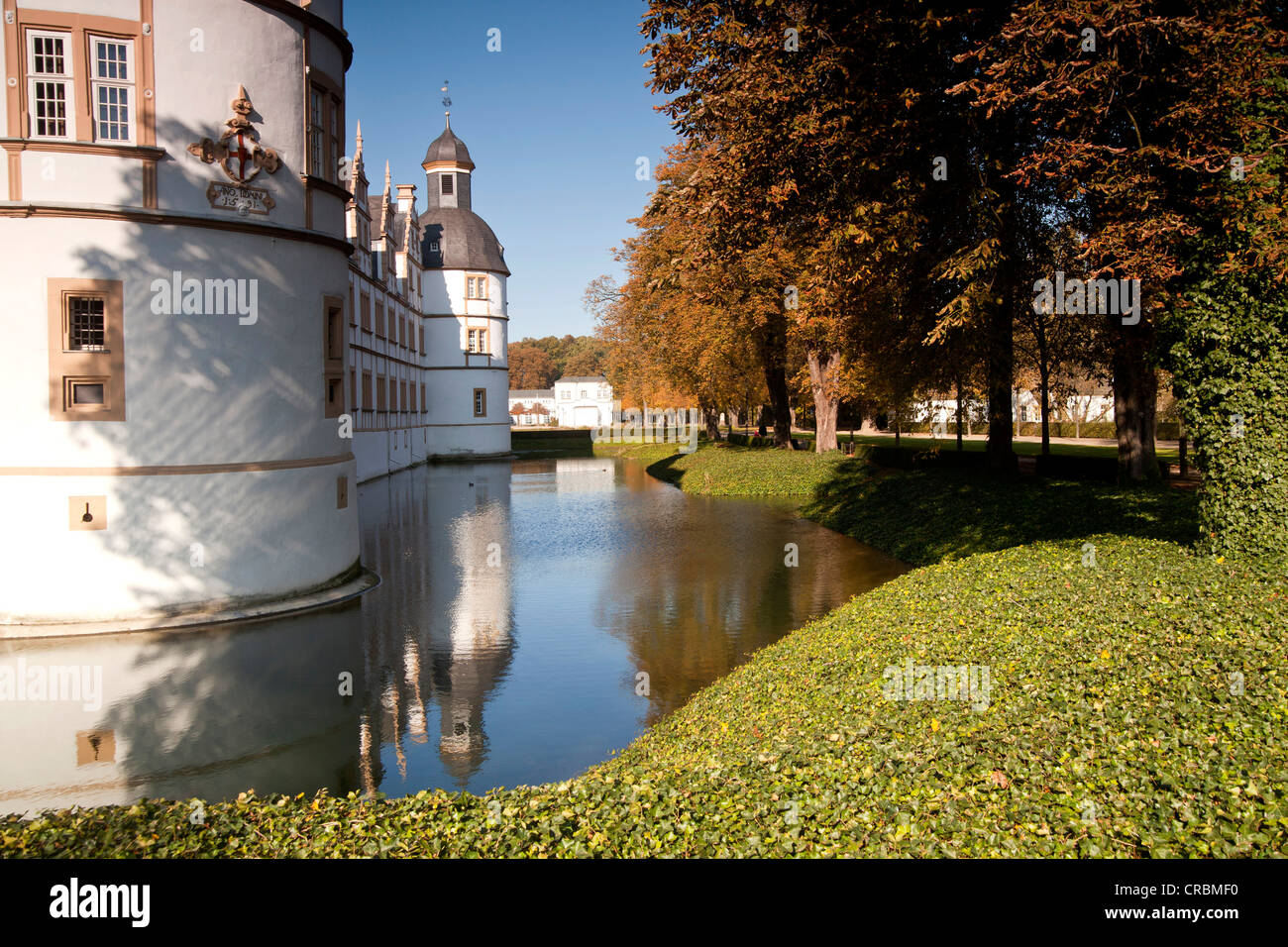 Moat around Schloss Neuhaus castle, an outstanding Weser-Renaissance building in Paderborn, North Rhine-Westphalia - Stock Image